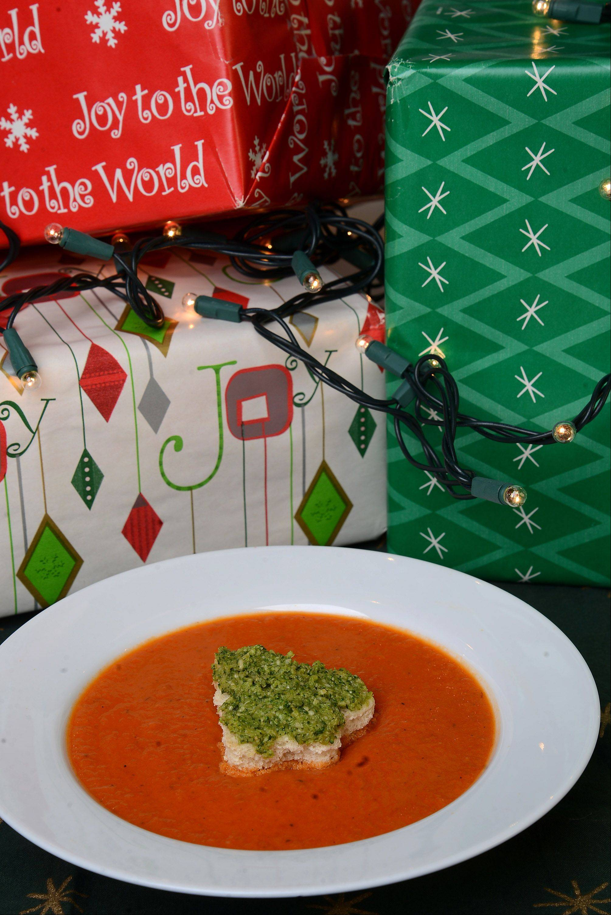 Broccoli pesto Christmas tree croutons make roasted red pepper soup extra festive.