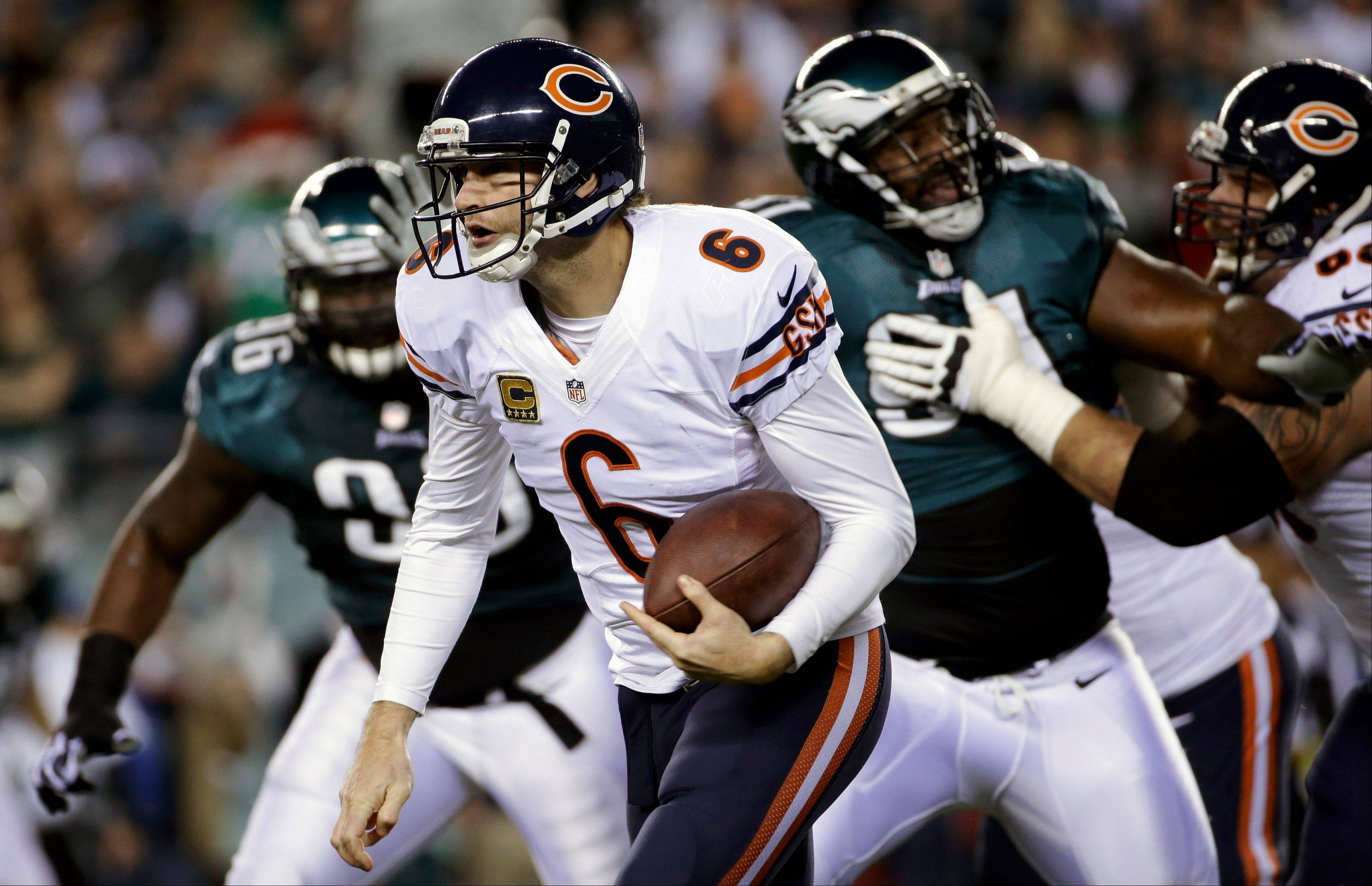 Chicago Bears' Jay Cutler scrambles during the first half of an NFL football game against the Philadelphia Eagles, Sunday, Dec. 22, 2013, in Philadelphia.