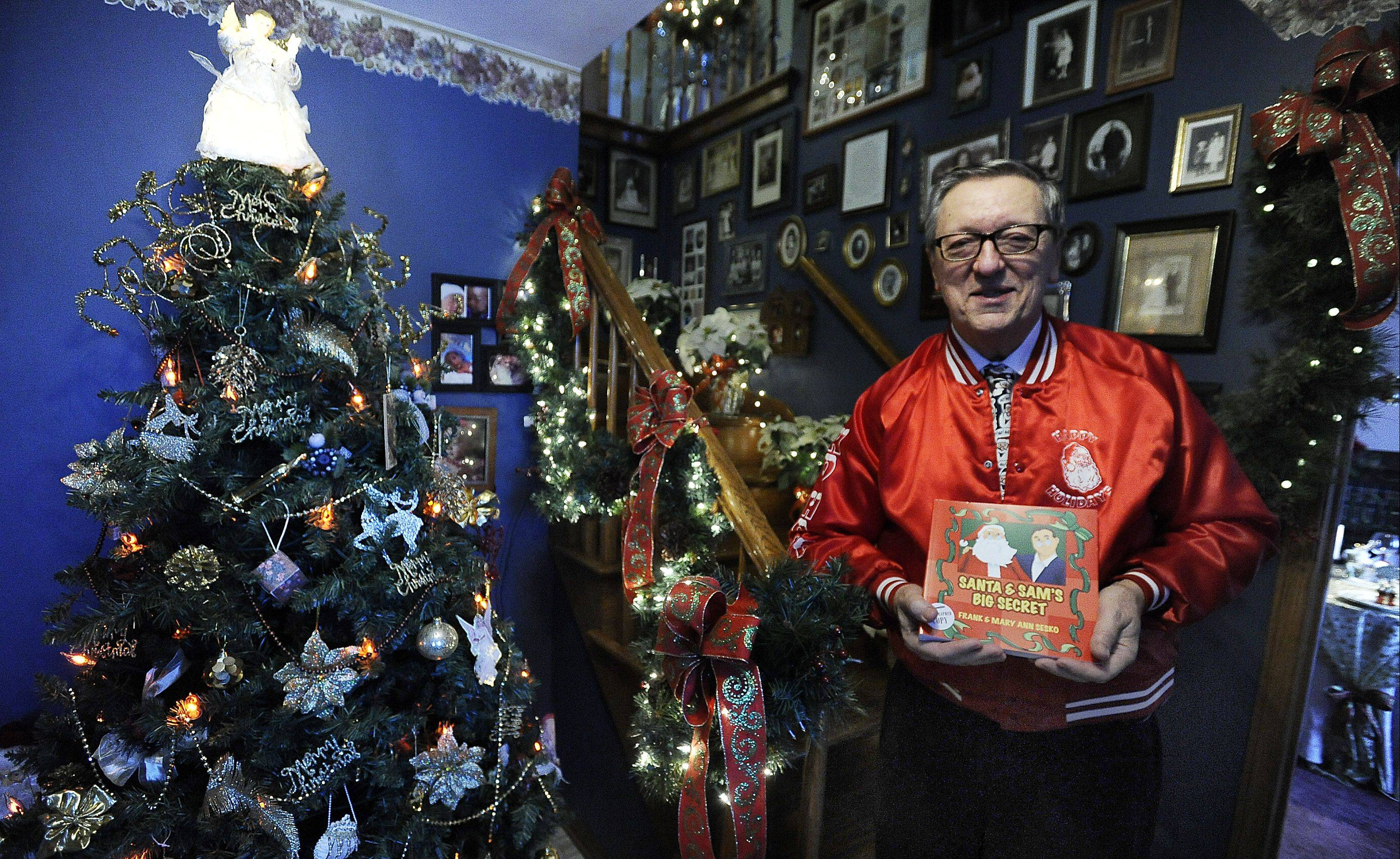 Frank Sesko stands by the entry tree, one of 18 in the Inverness home he shares with his wife, Mary Ann.