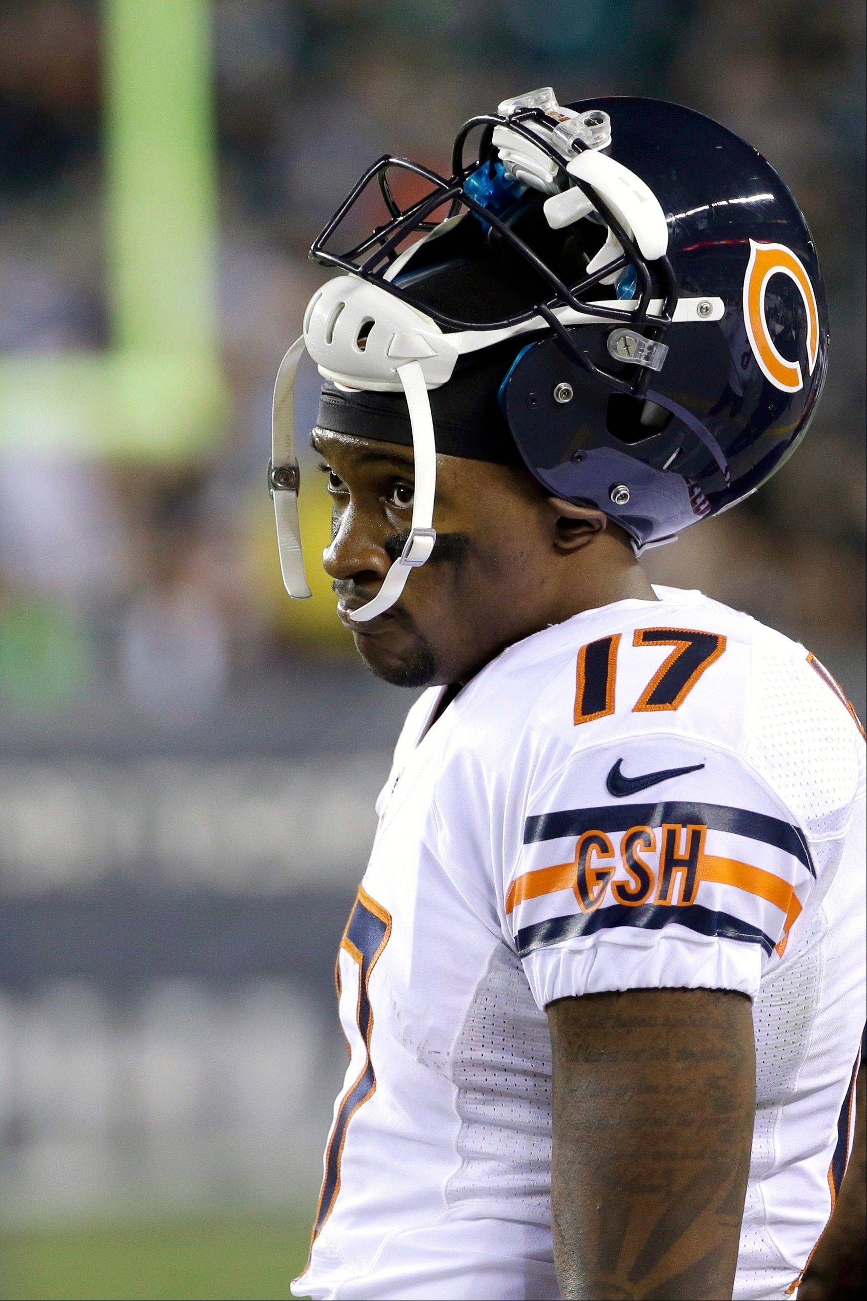 Bears receiver Alshon Jeffery watches from the sidelines during the second half of an NFL football game against the Philadelphia Eagles, Sunday, Dec. 22, 2013, in Philadelphia.