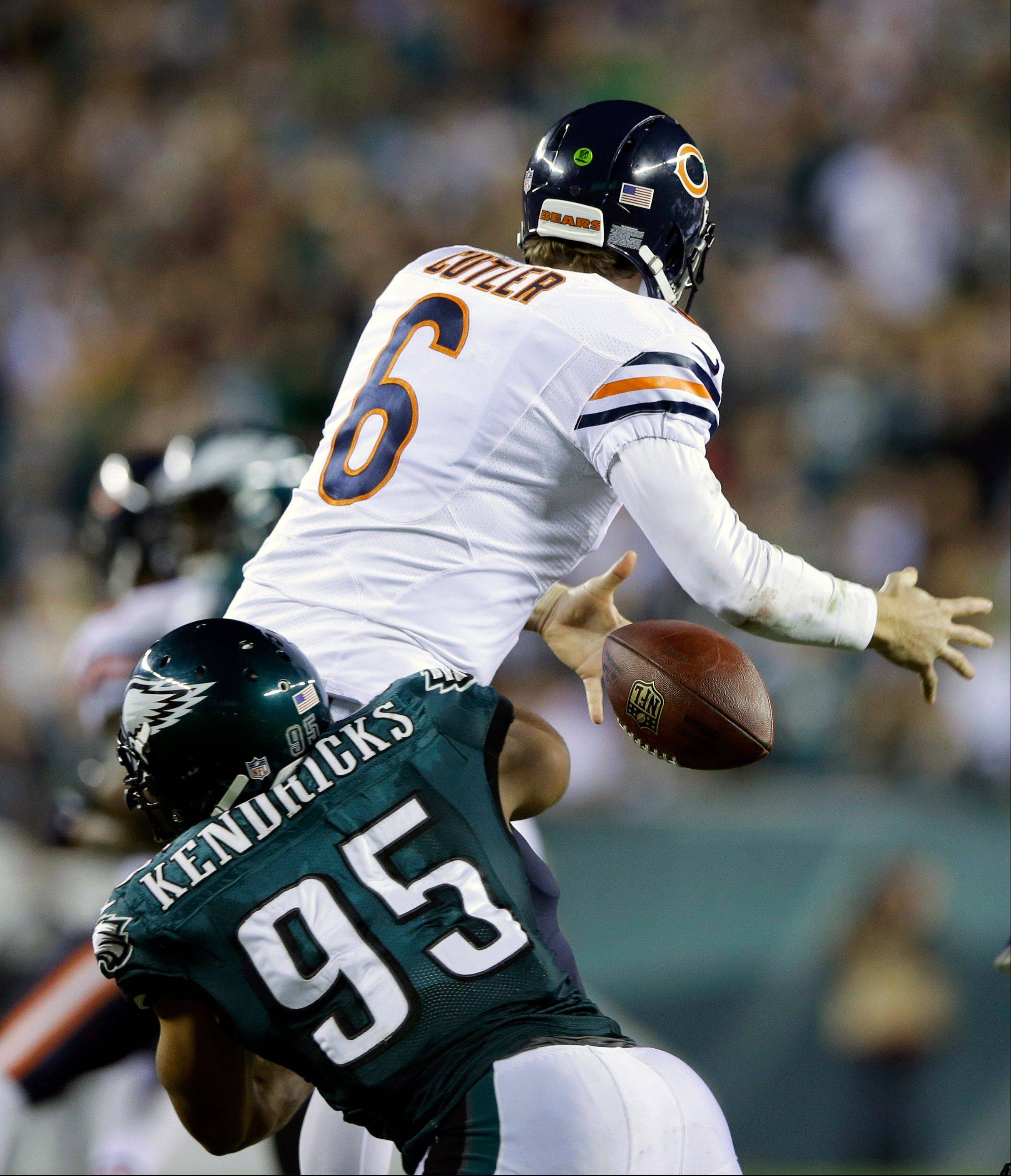 Bears quarterback Jay Cutler fumbles the ball as he is hit by the Eagles� Mychal Kendricks during the second half Sunday night.
