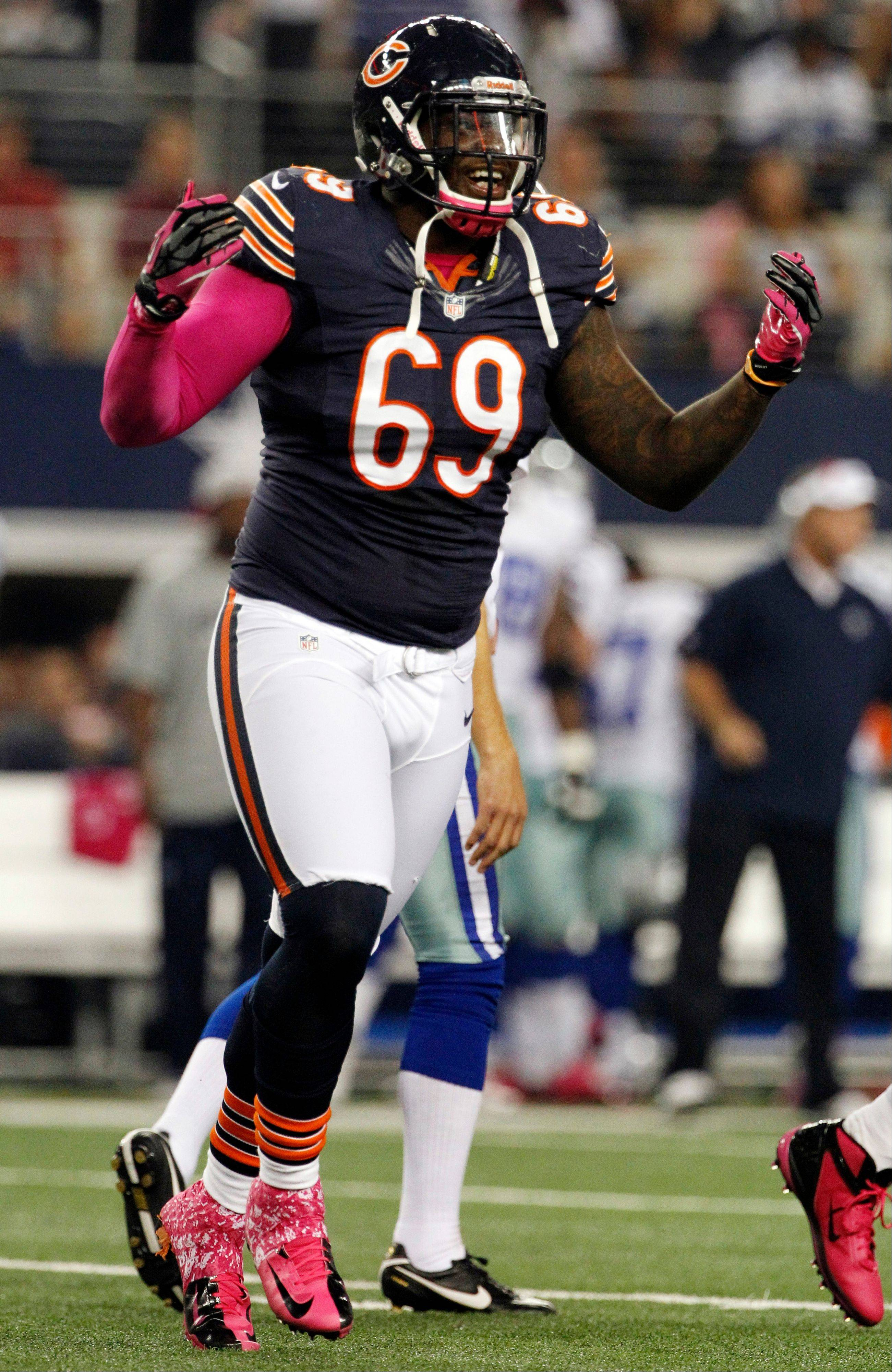 Chicago Bears defensive tackle Henry Melton, shown here celebrating a sack in a game last year against the Dallas Cowboys, was arrested early Sunday morning after an altercation at a suburban Dallas bar. Police said Melton, who is out for the season with a knee injury, was charged with assault and public intoxication.