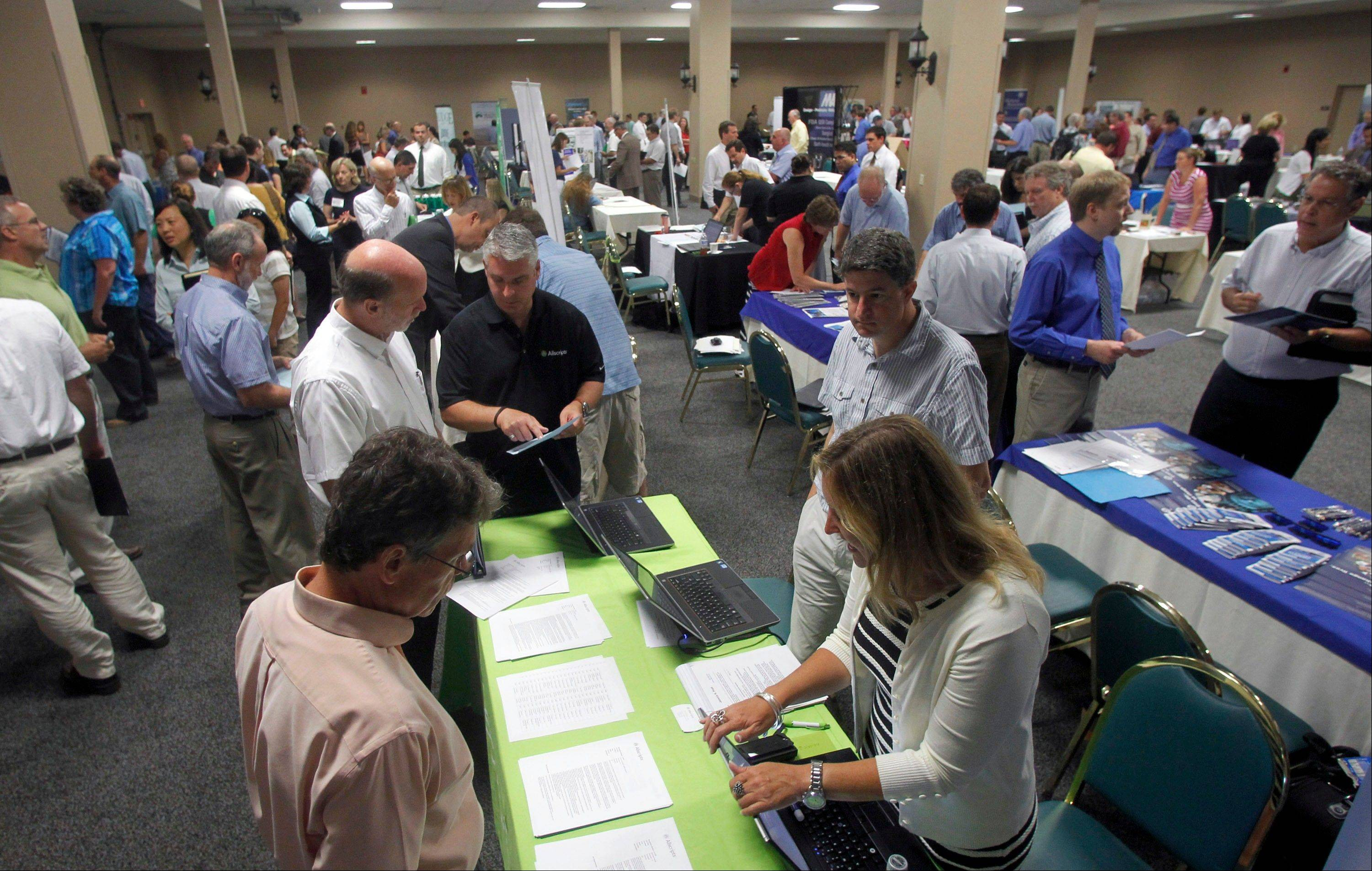 People fill up a job fair in South Burlington, Vt. Small businesses hired at a slow pace during 2013.