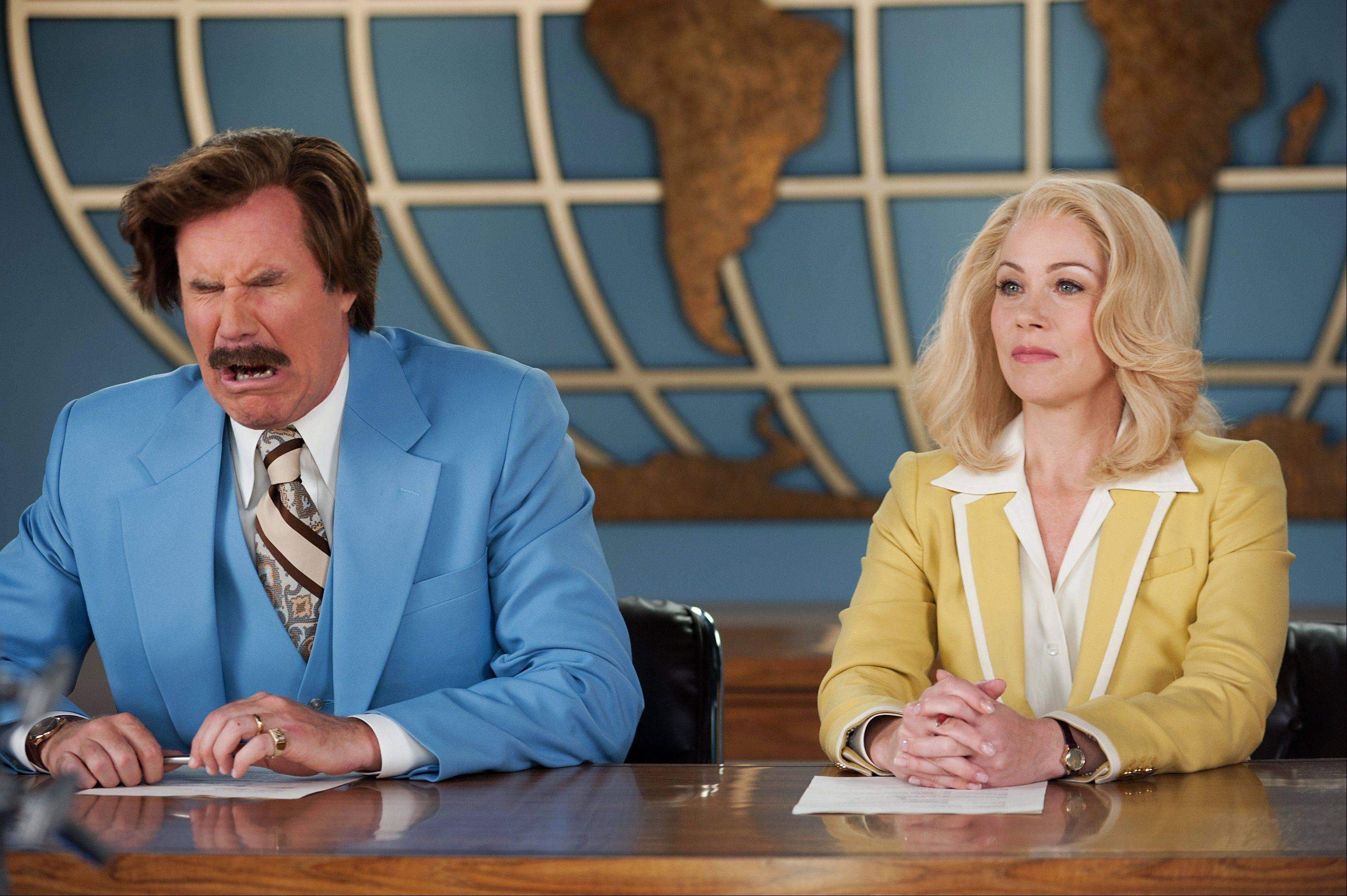 "This photo provided by Paramount Pictures shows Will Ferrell, left, as Ron Burgundy and Christina Applegate as Veronica Corningstone, in a scene from the film, ""Anchorman 2: The Legend Continues."" The sequel has brought in $40 million since it opened on Tuesday night."