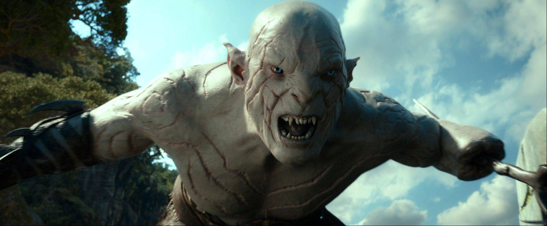 "This file film image released by Warner Bros. Pictures shows a scene from ""The Hobbit: The Desolation of Smaug."" Per studio estimates Sunday, Warner Bros. ""Hobbit: The Desolation of Smaug"" was No. 1 at the weekend box office with $31.5 million."