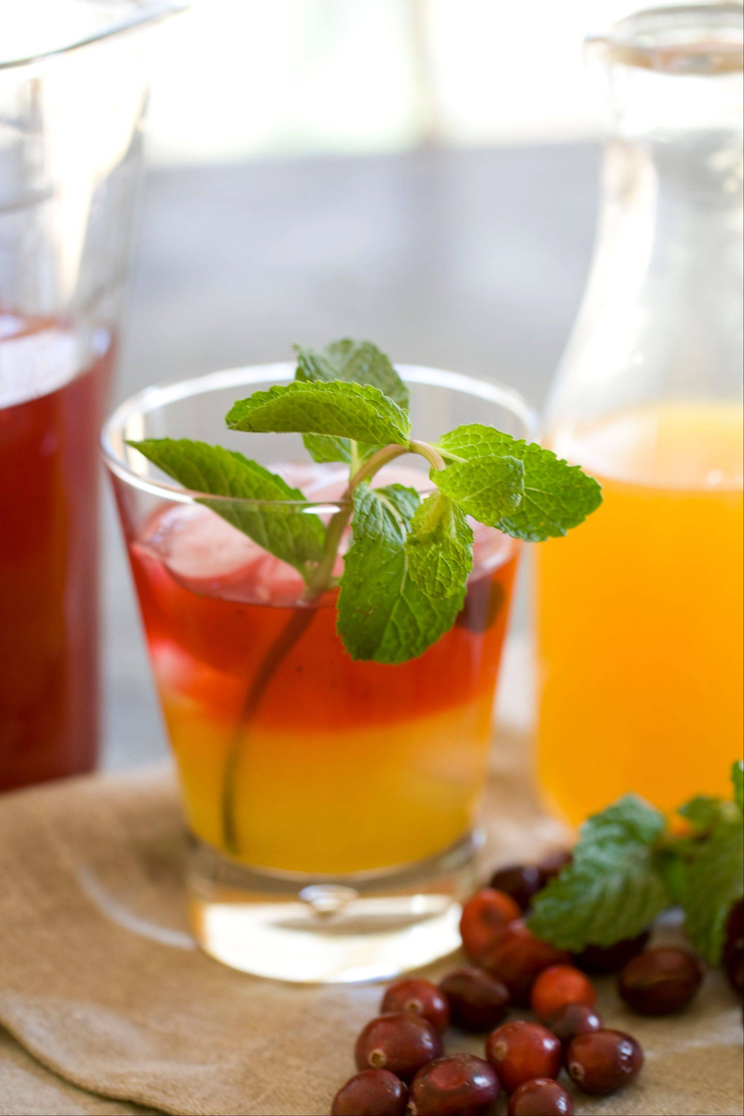 Cranberry-Mint Infused Margaritas are sweetened with agave nectar.
