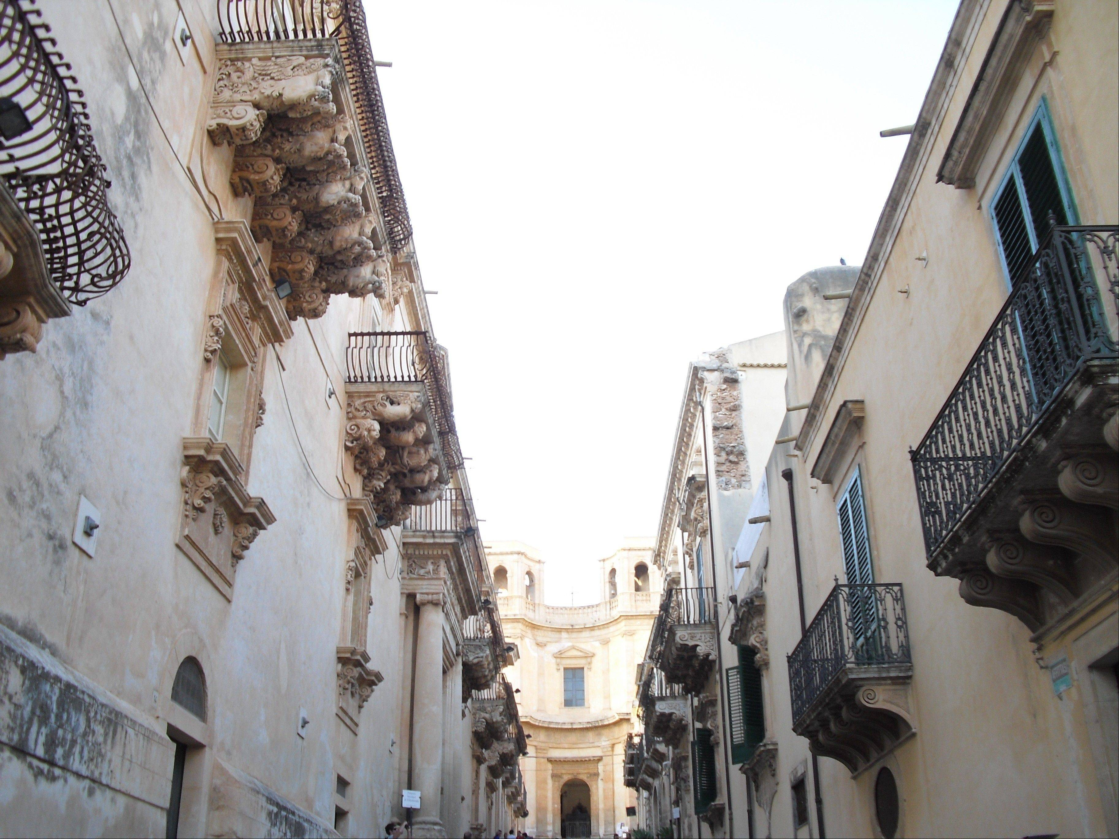 The Palazzo Villadorata, left, and the Palazzo Sant' Alfano frame the Chiesa di Montevergine in the Sicilian city of Noto.