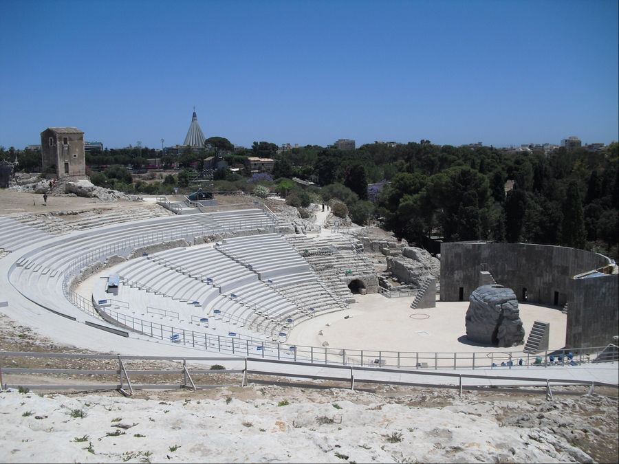 The ancient Greek Theater in the Parco Archeologico della Neapolis in Syracuse, Italy, is still in use today. Greek plays performed in Italian translation are presented as part of the annual Teatro Greco di Siracusa Festival.