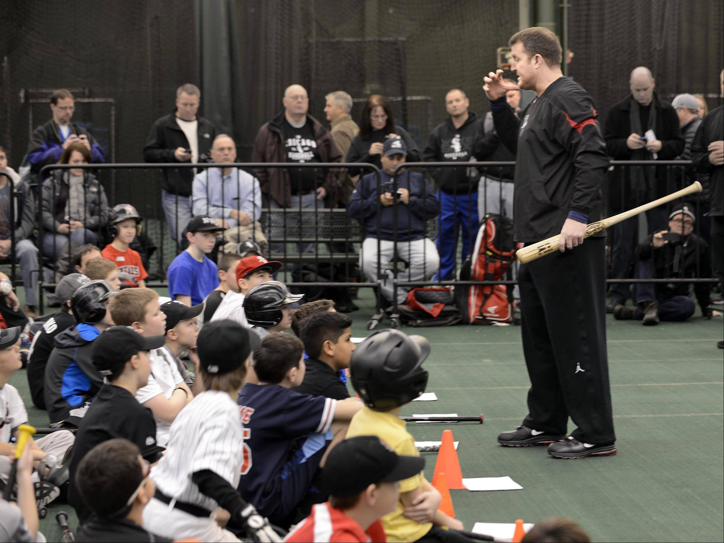 "Five-time Major League Baseball All-Star and former Chicago White Sox slugger Jim Thome works with young players Sunday on hitting at the Chicago Bulls/White Sox Academy in Lisle. ""This is great. It's fun to give back,"" Thome said."