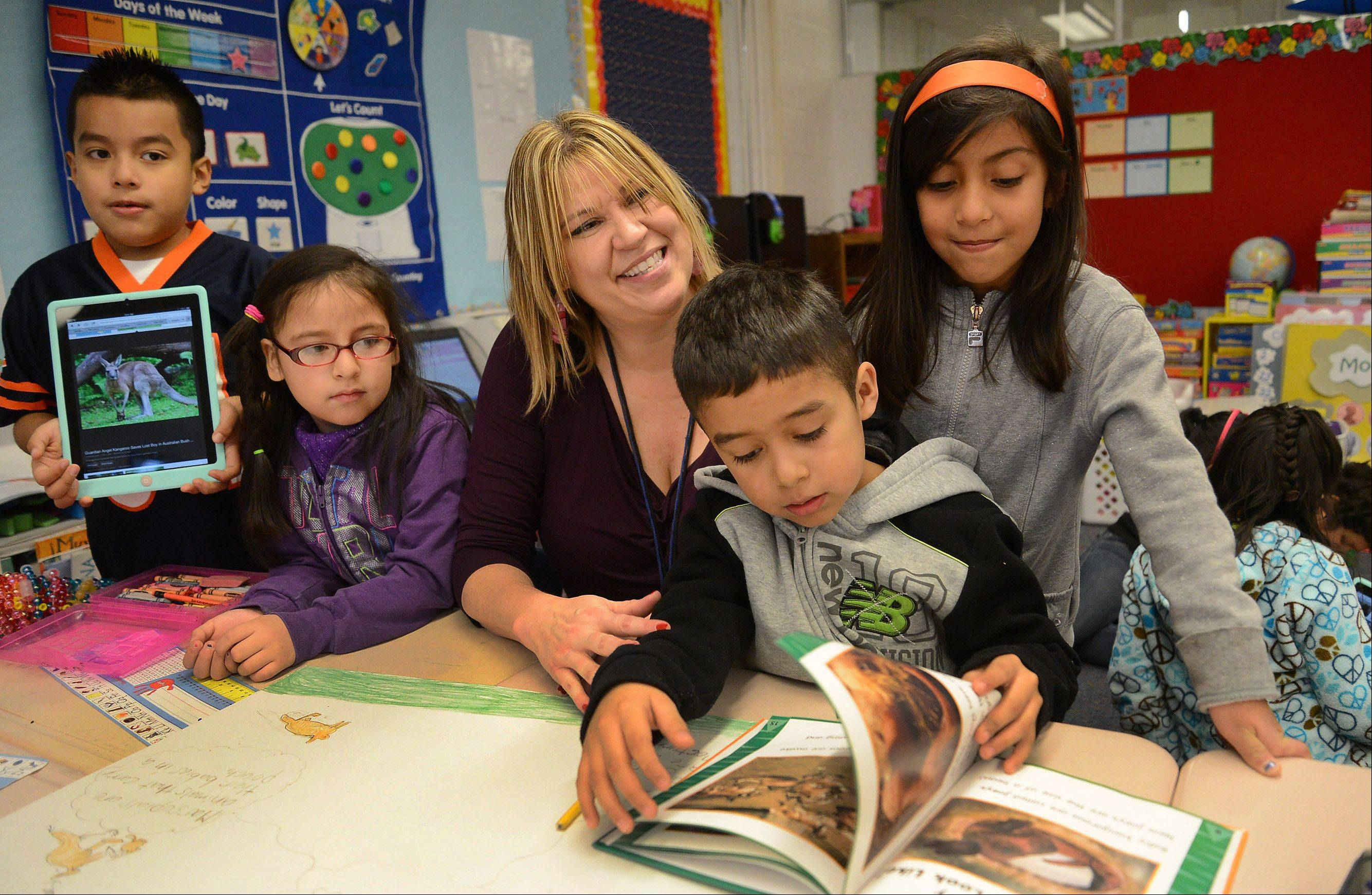 Jacque Erickson teaches a bilingual multi-age class of first- and second-graders, including Brayan Ponce, Ashley Aguilar, Victor Navidad and Emily Medina, at Jane Addams Elementary School in Palatine Elementary District 15, where the student minority population has grown to 56 percent.