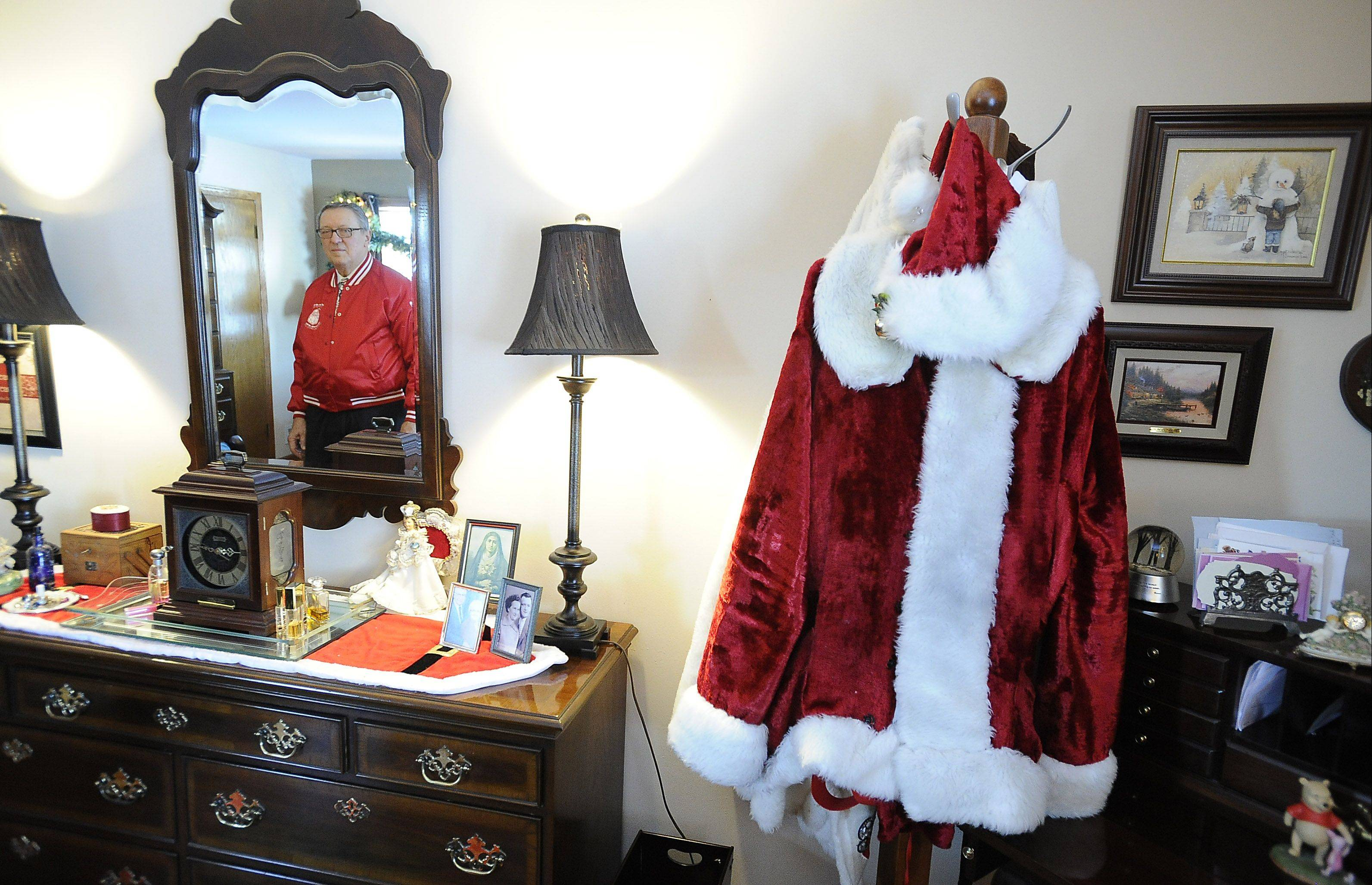 "Mary Ann Sesko made a Santa suit for her husband, Frank, who for almost 50 years has been ""taking Santa"" to visit nursing homes, friends and schools."