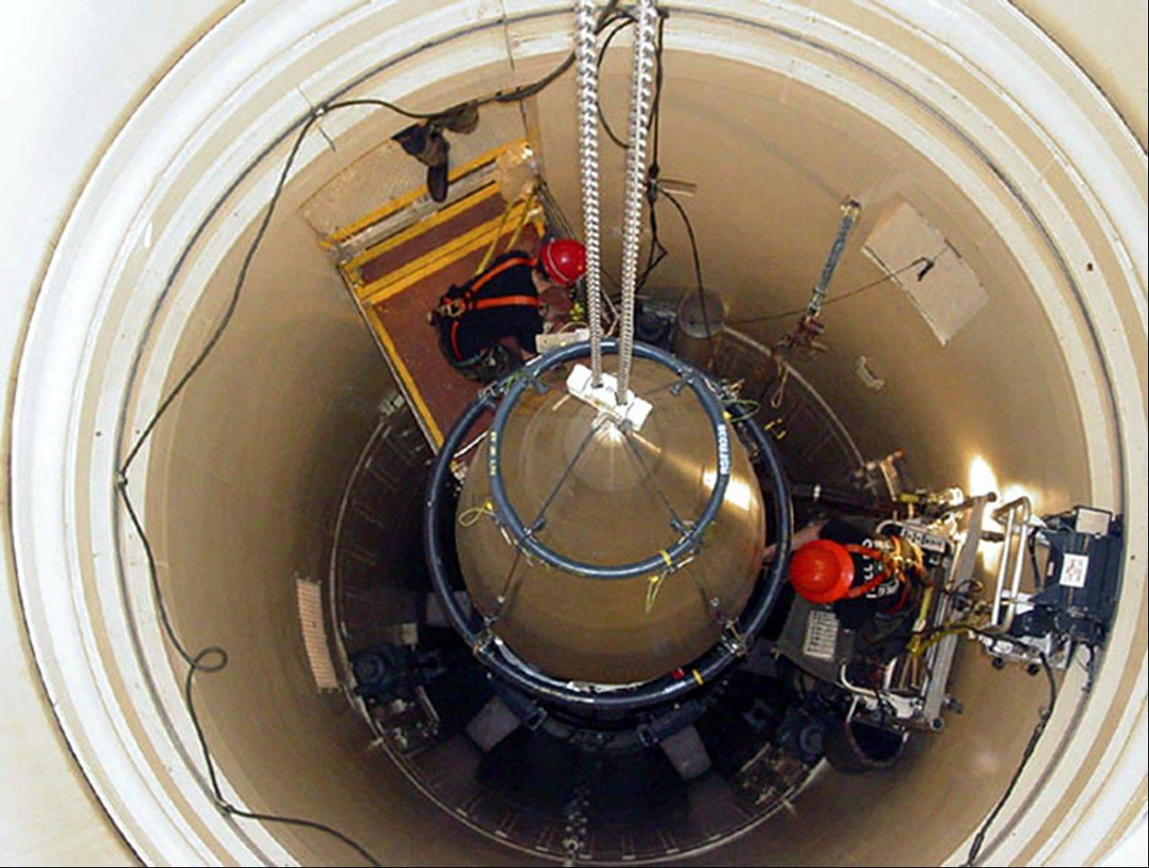 A Malmstrom Air Force Base missile maintenance team removes the upper section of an ICBM
