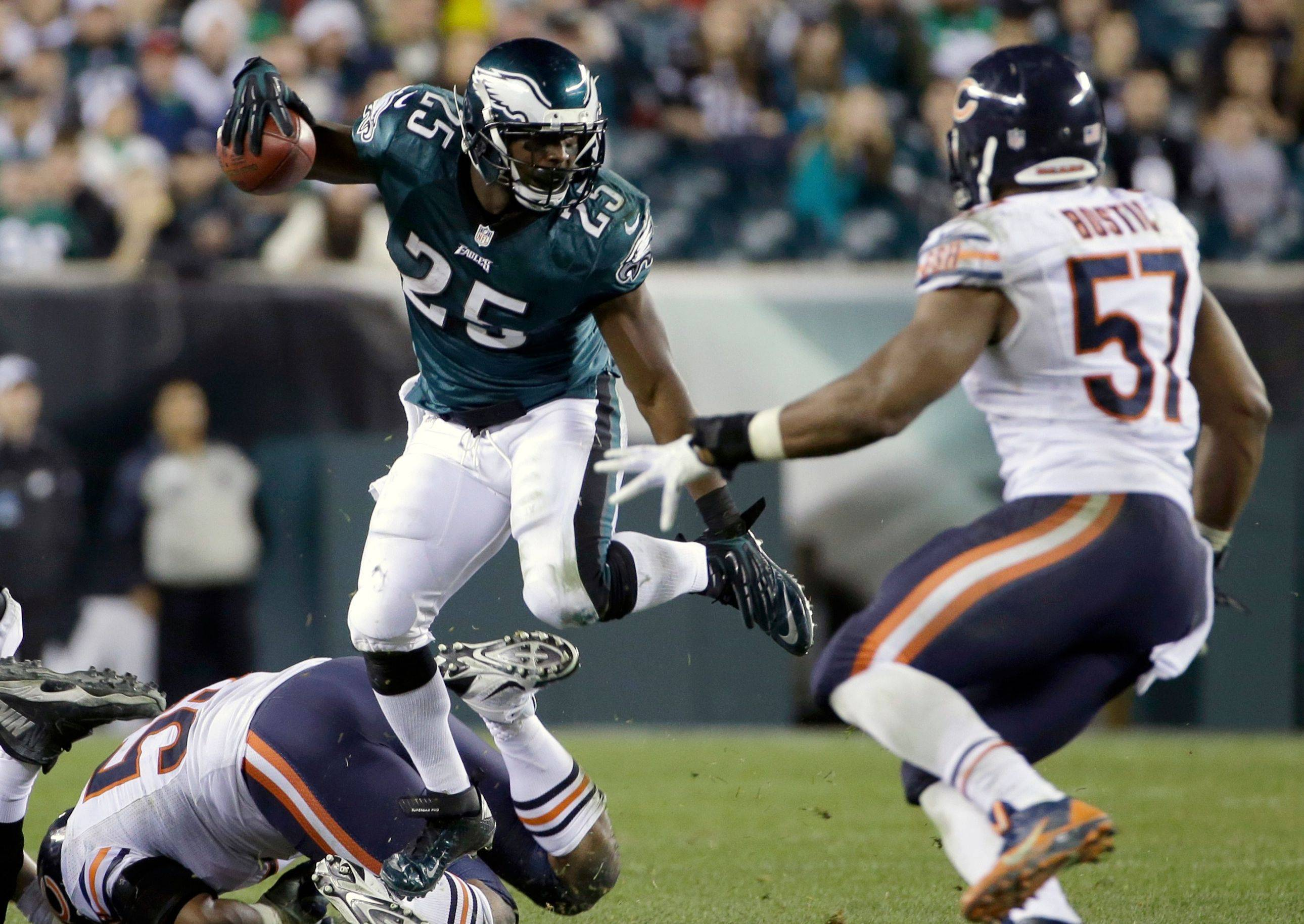 LeSean McCoy looks for room to run as Bears linebacker Jonathan Bostic attempts to close in during the Eagles' win Sunday. McCoy rumbled for 133 yards and now has 1,476 on the season.