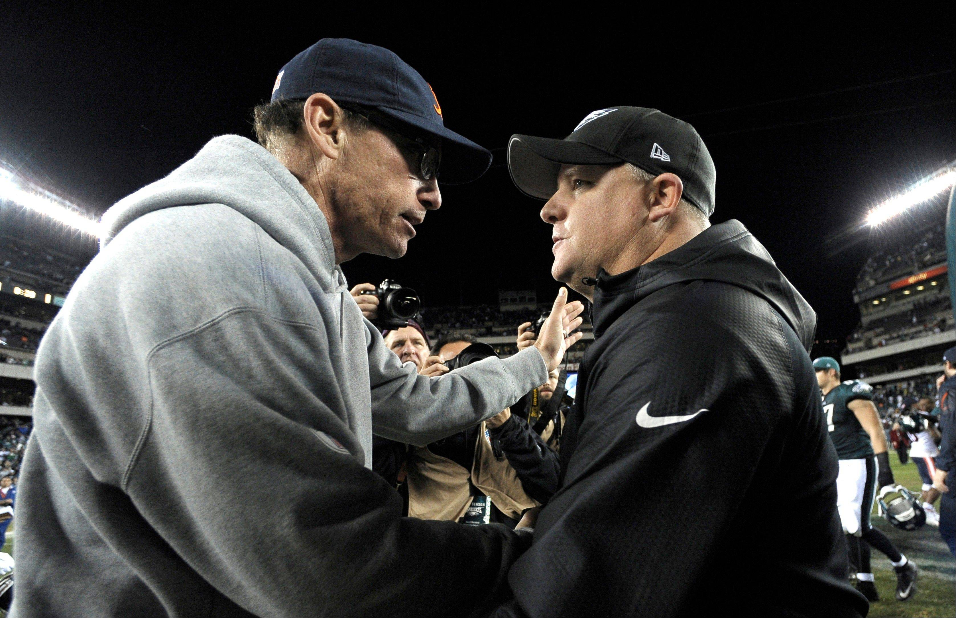 Bears coach Marc Trestman, left, and Eagles coach Chip Kelly meet on the field after Philadelphia's rout of the Bears on Sunday night.
