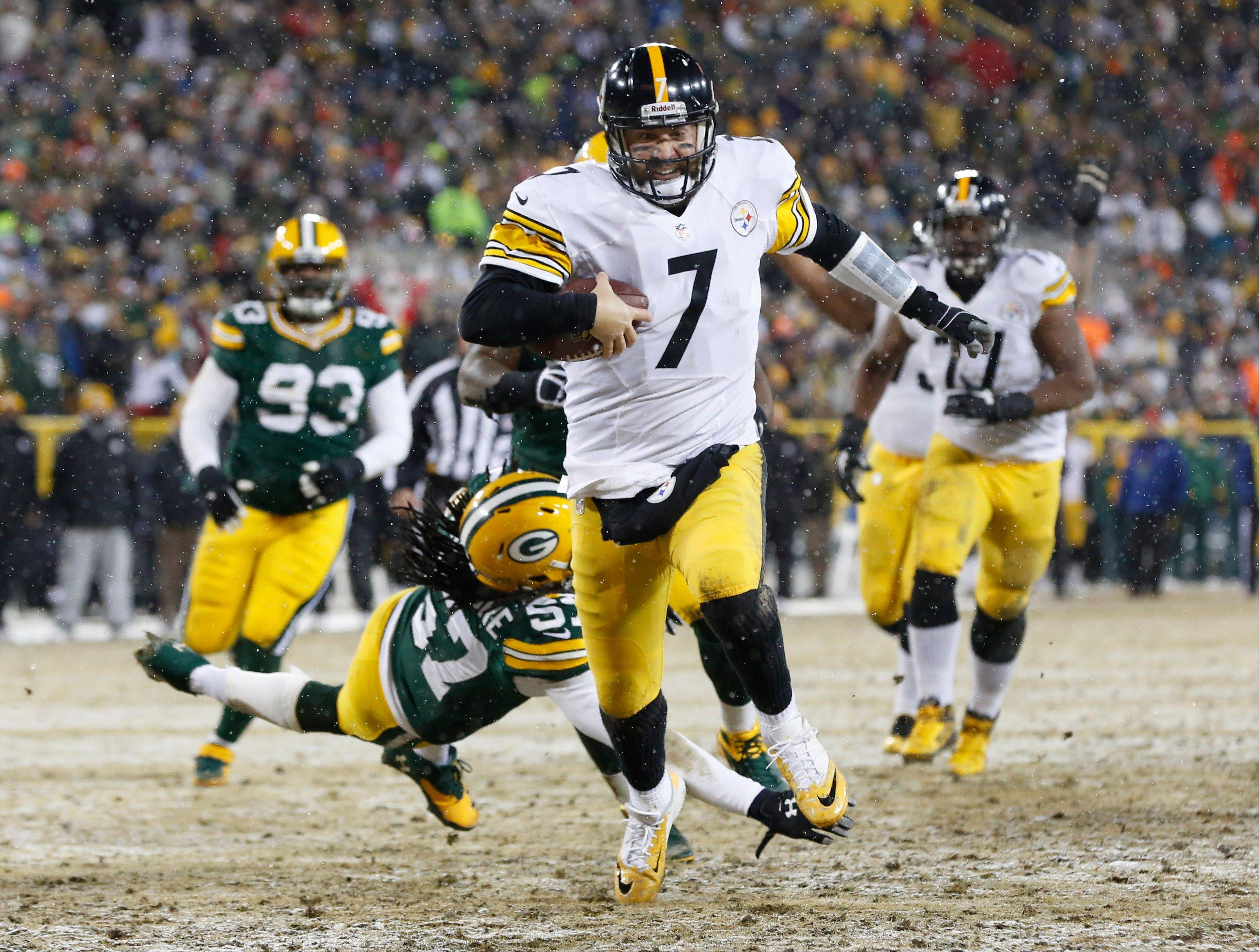 Pittsburgh Steelers' Ben Roethlisberger breaks away from Green Bay Packers' Jamari Lattimore (57) for a touchdown run during the second half of an NFL football game Sunday, Dec. 22, 2013, in Green Bay, Wis.