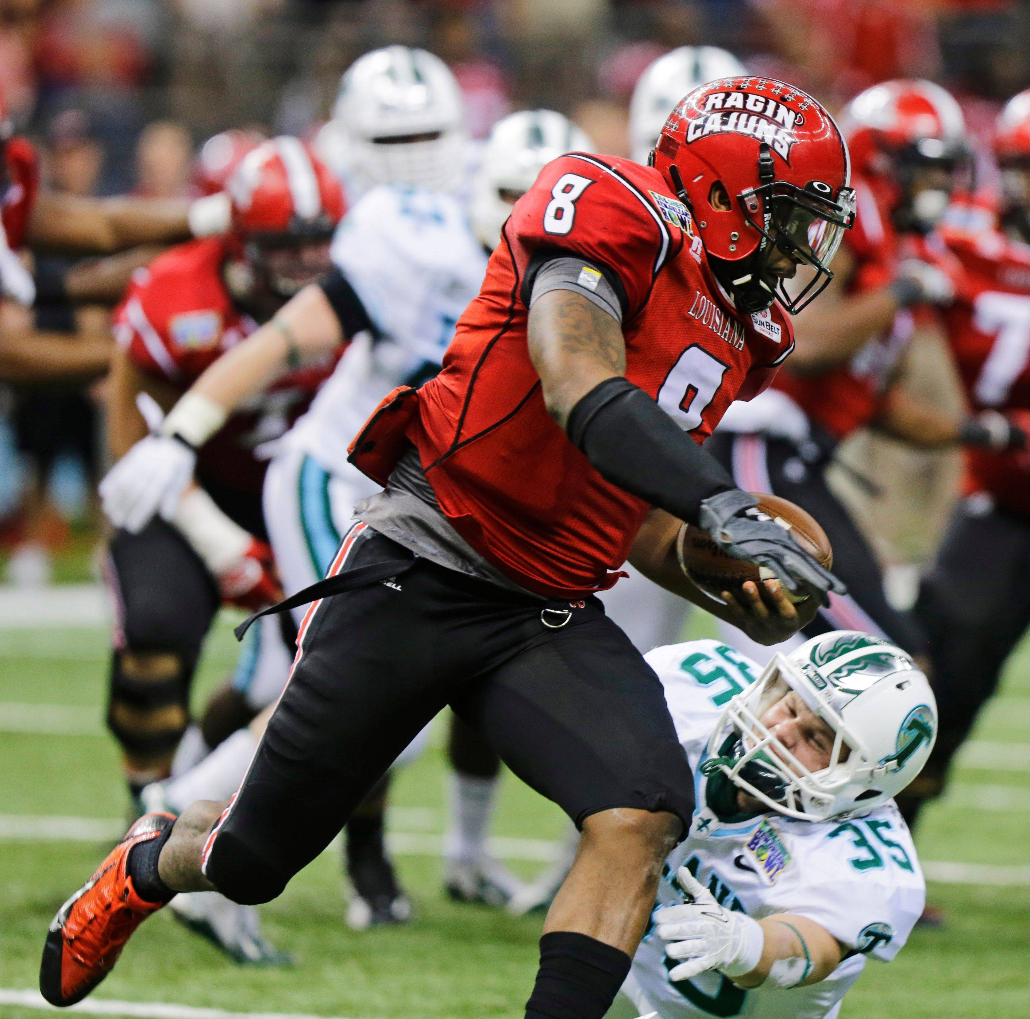 Louisiana-Lafayette quarterback Terrance Broadway gets around Tulane safety Sam Scofield during the second half of the New Orleans Bowl on Saturday.