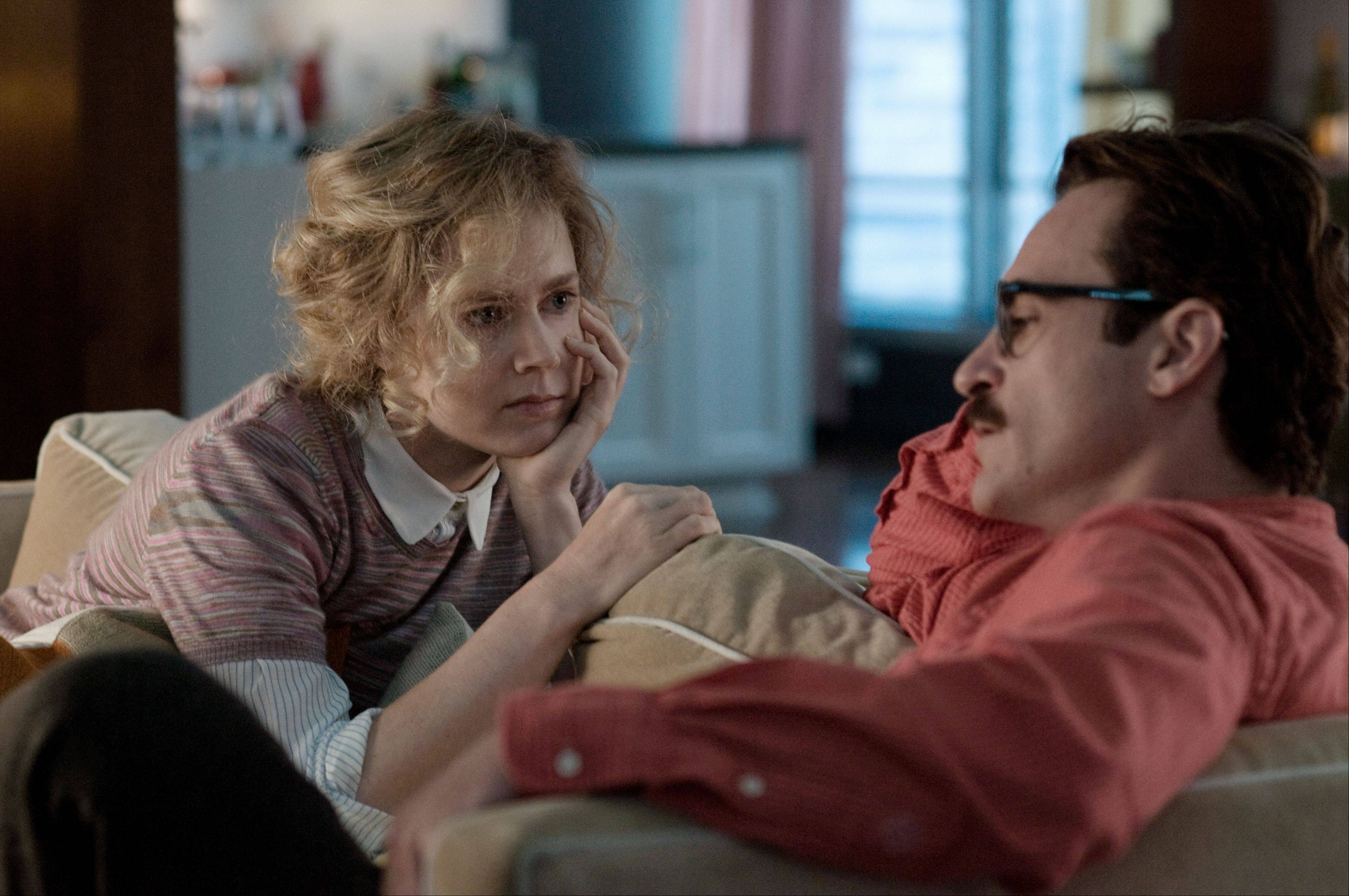 "Amy (Amy Adams) accepts Theodore's (Joaquin Phoenix) growing feelings for a virtual program called Samantha in Spike Jonze's ""Her."""