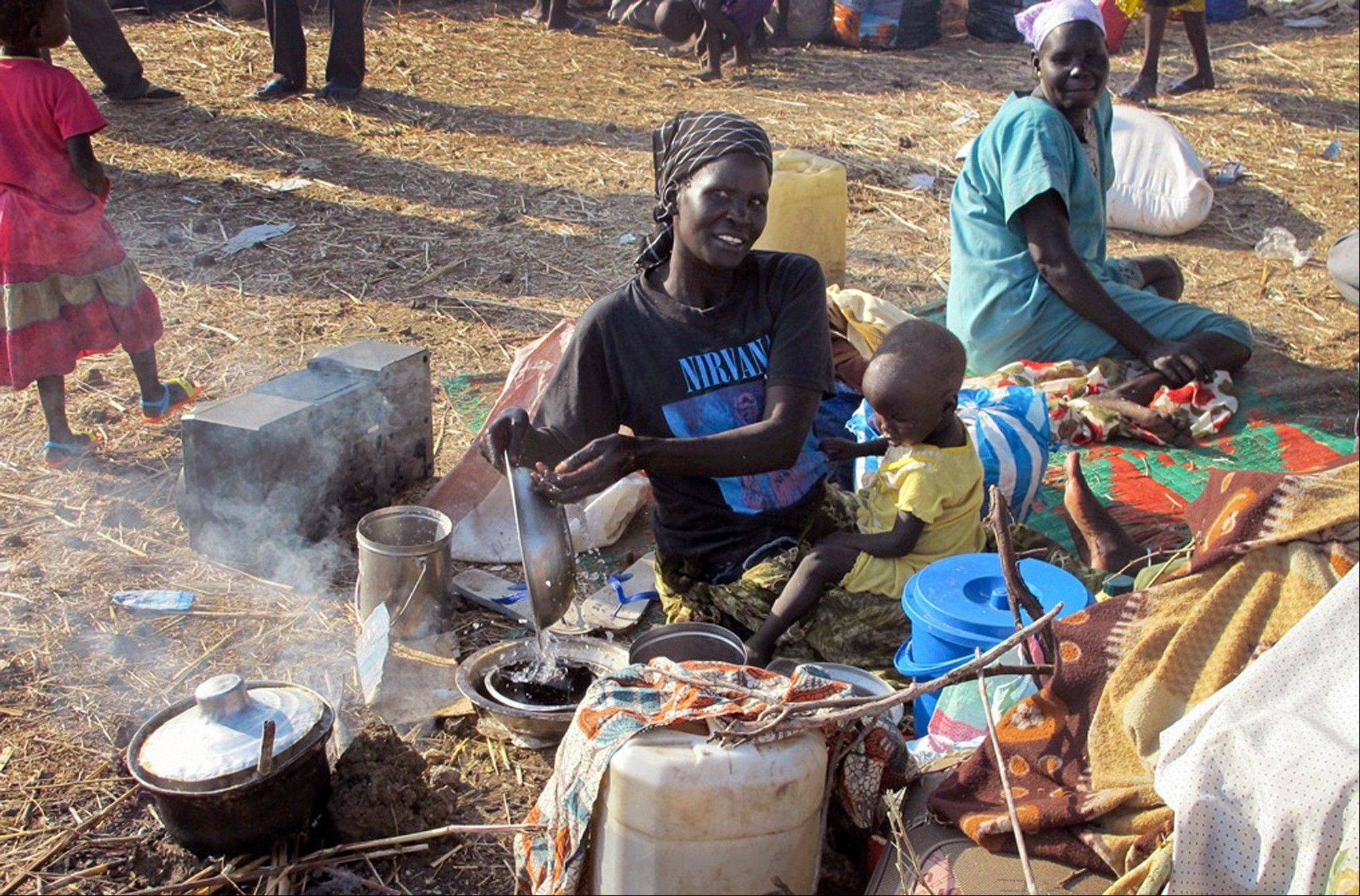In this photo taken Sunday, displaced people take shelter in the U.N. compound where they get assistance from the World Food Program, in Bentiu, the capital of the oil-producing Unity state, in South Sudan.