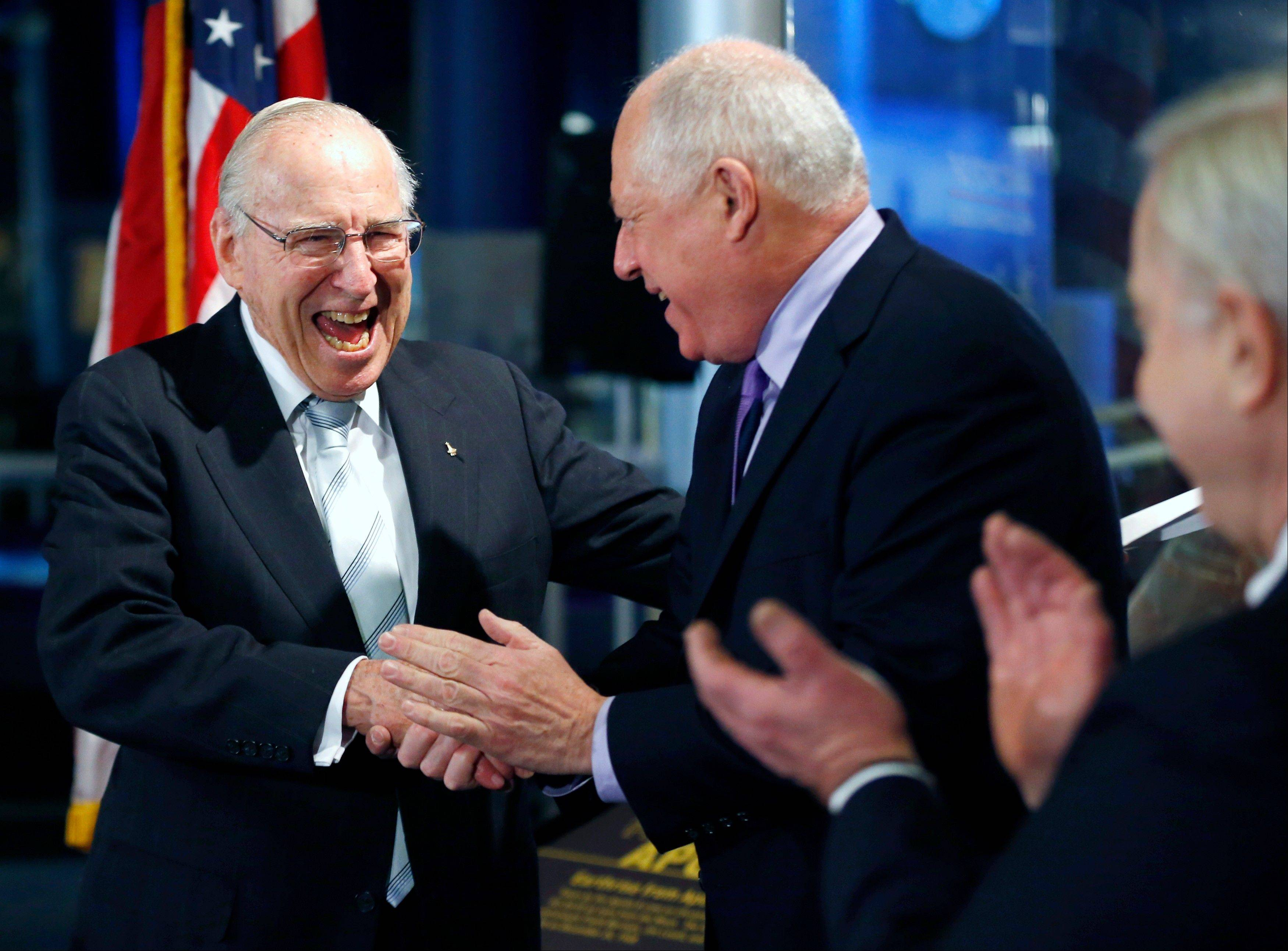 Captain James A. Lovell, Jr., left, shares a laugh with Gov. Pat Quinn, center, and David R. Mosena, CEO of Chicago�s Museum of Science and Industry,, during the 45th anniversary of Apollo 8 �Christmas Eve Broadcast to Earth� event Monday at the museum.
