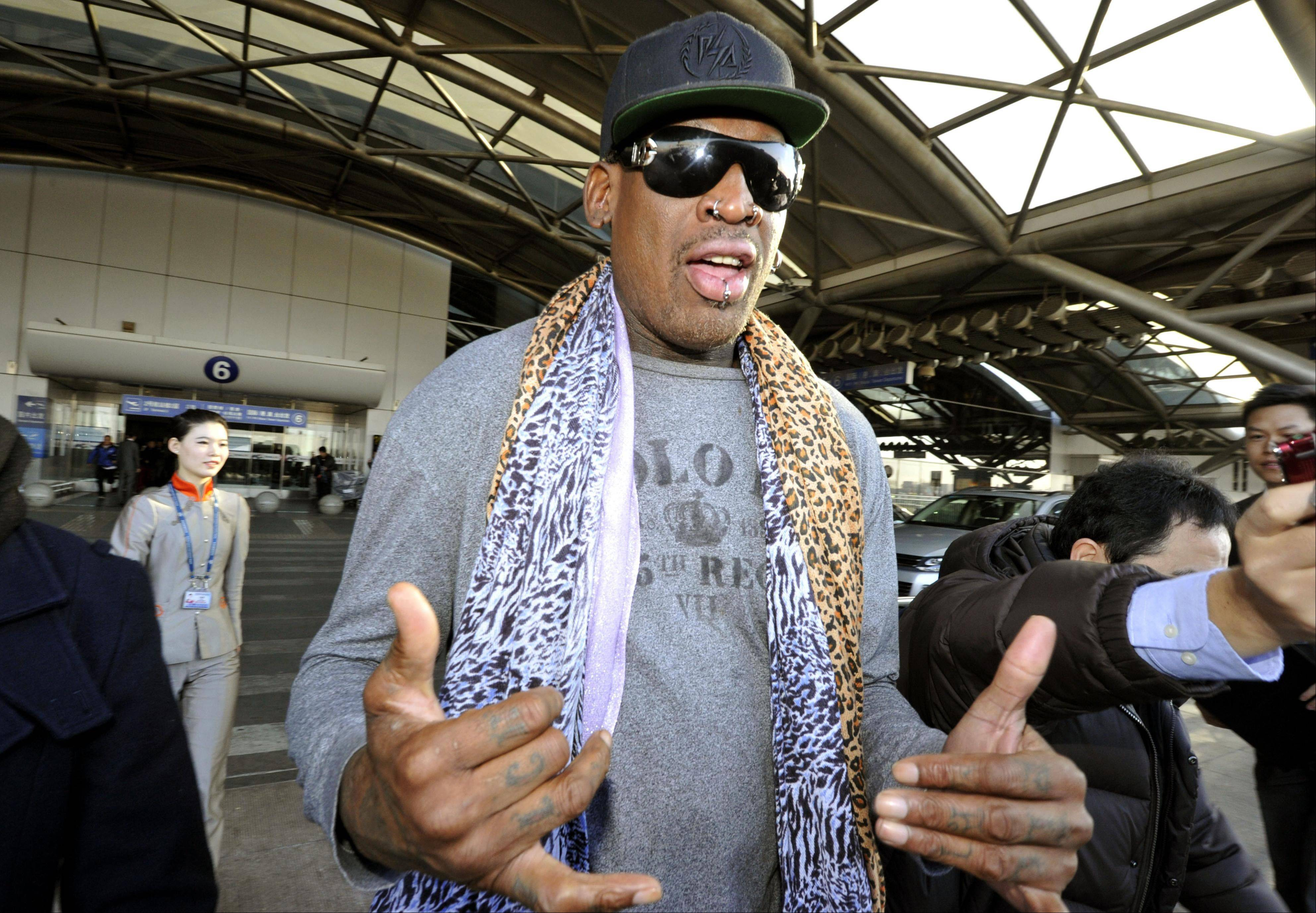 Former basketball star Dennis Rodman speaks to journalists upon arrival at the capital airport in Beijing from Pyongyang, North Korea, Monday. Rodman left North Korea on Monday, but didn�t answer questions from the media on whether he had met with leader Kim Jong Un on his latest visit.
