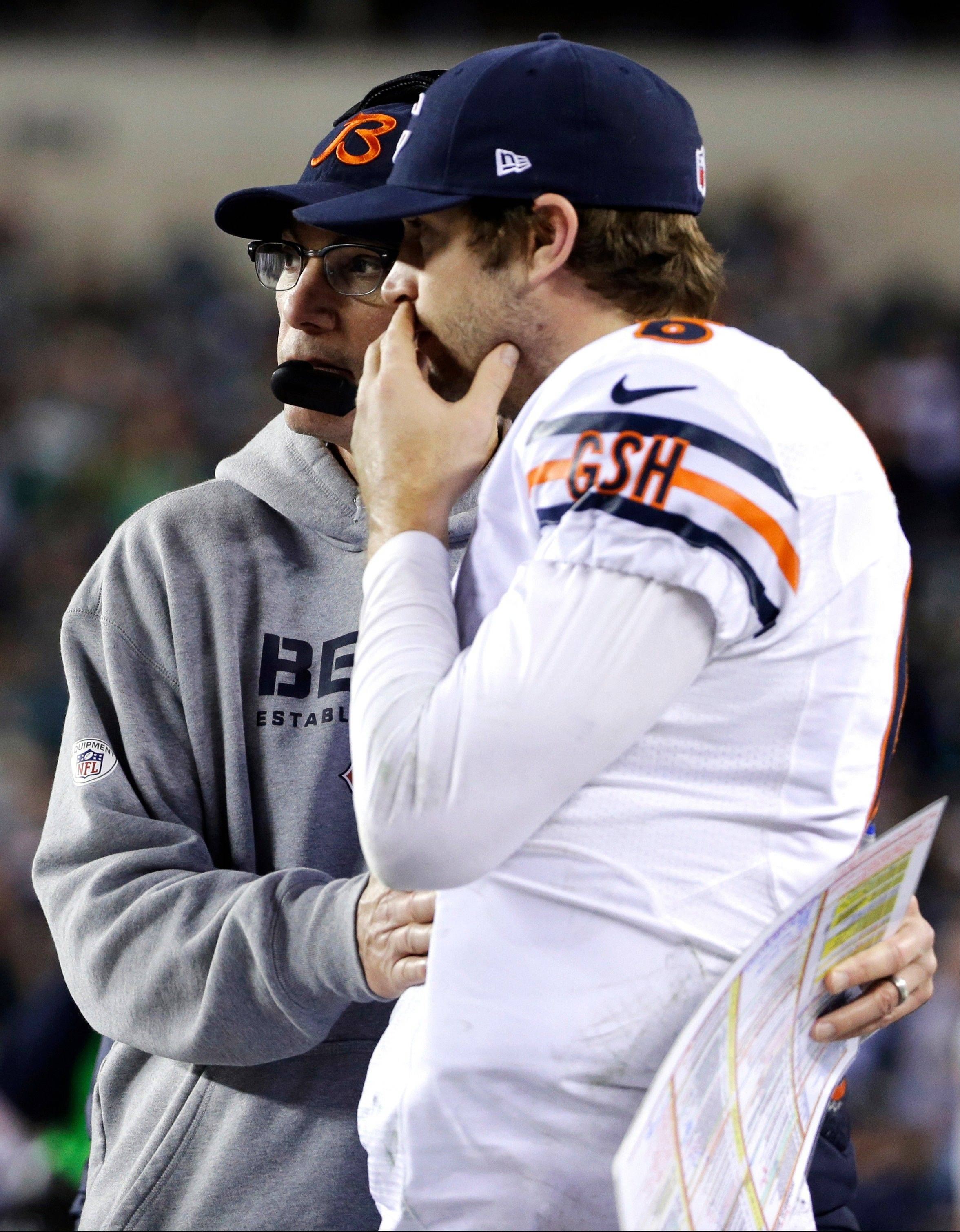 Bears head coach Marc Trestman, left, embraces Jay Cutler on the sidelines during the second half of an NFL football game Sunday in Philadelphia. The Bears lost 54-11 to set up a playoff contest in next week's game against the Packers at Soldier Field.