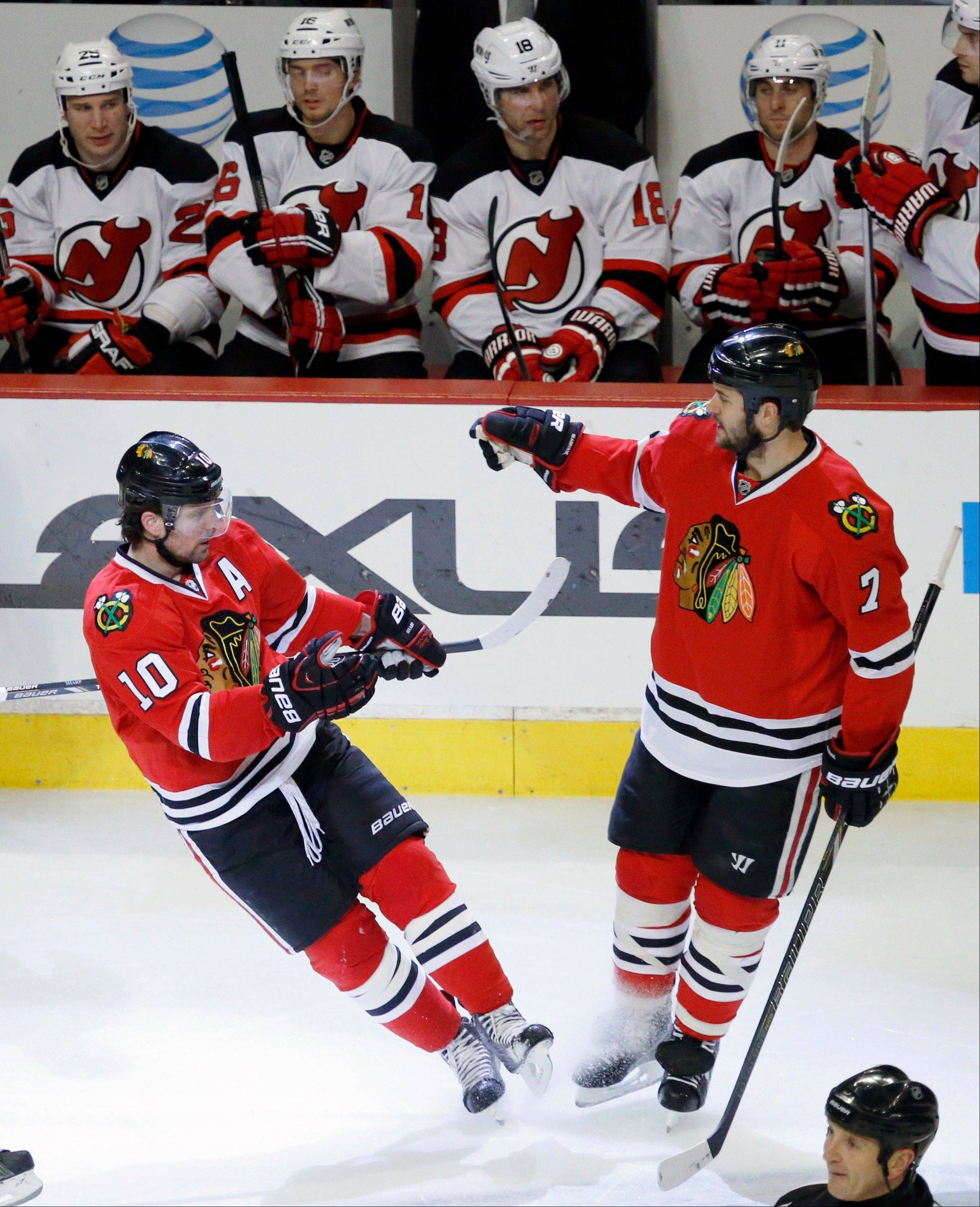 Patrick Sharp, left, celebrates his second goal of the game with Brent Seabrook, giving the Blackhawks some breathing room.