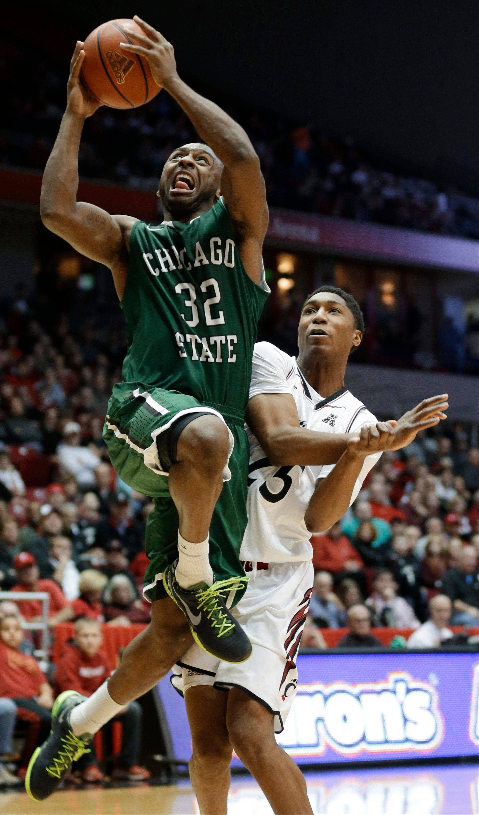 Chicago State guard Nate Duhon drives against Cincinnati guard Kevin Johnson during the second half of Monday�s game in Cincinnati.