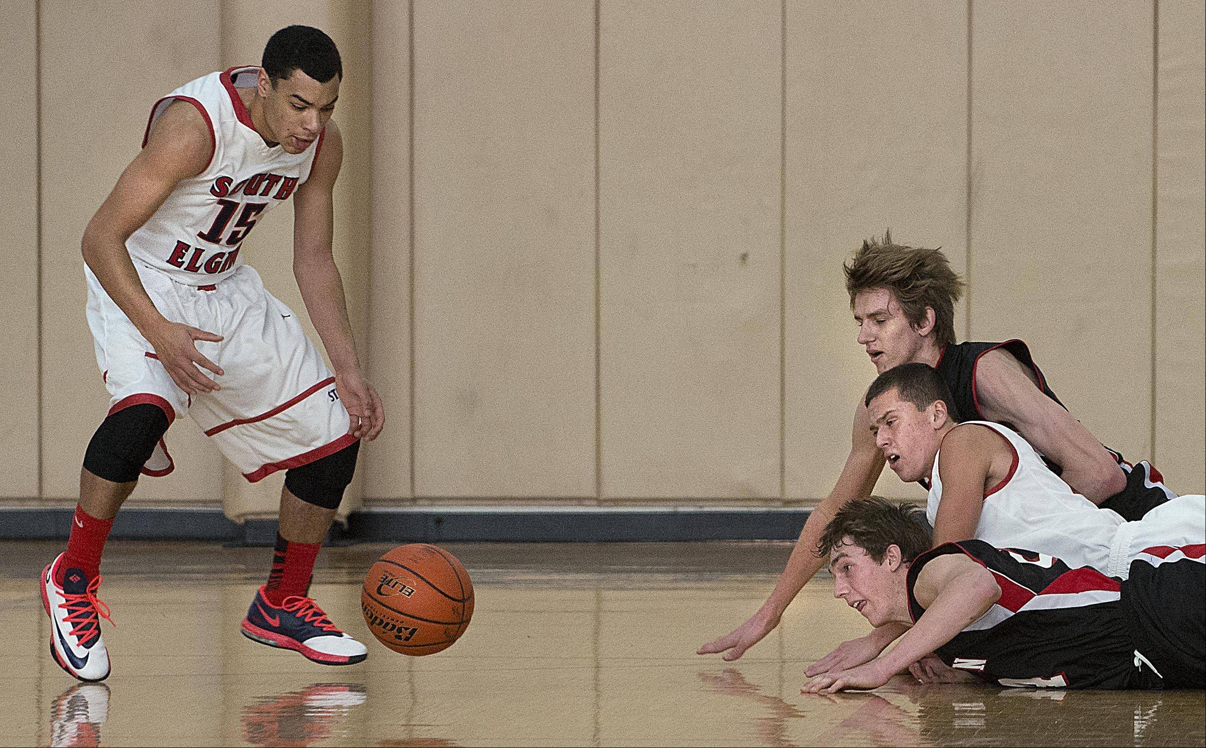 Barrington�s Rapolas Ivanauskas and West McDonald and South Elgin�s Matt McClure watch as South Elgin�s Matthew Smith reaches for a loose ball Monday at the Hinkle Holiday Classic at Jacobs High School in Algonquin.