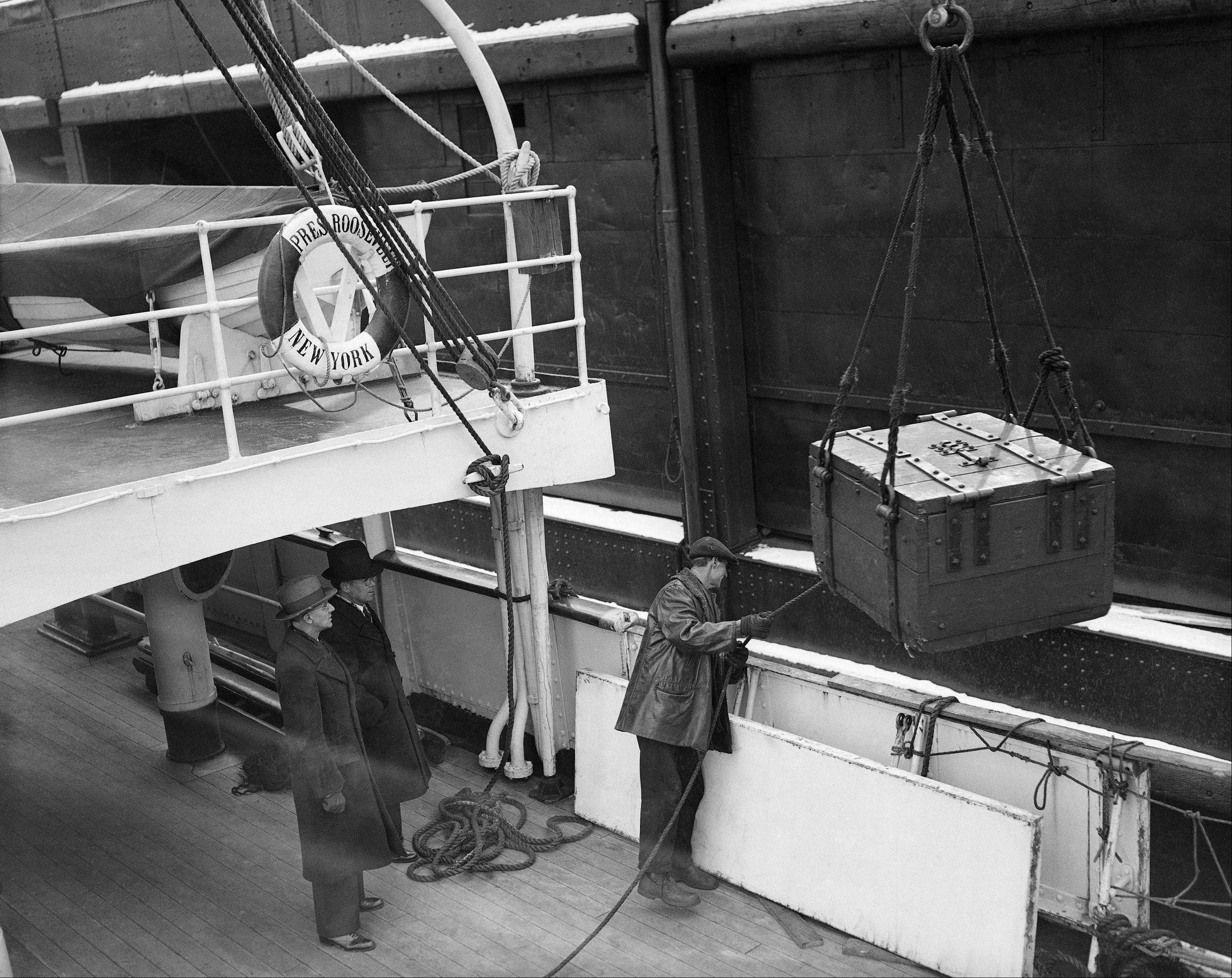 Workmen unload a shipment of 80,000,000 gold francs purchased by the U.S Goverment and consigned to the Federal Reserve Bank, following its arrival in New York, in this file photo from Feb. 5, 1934.