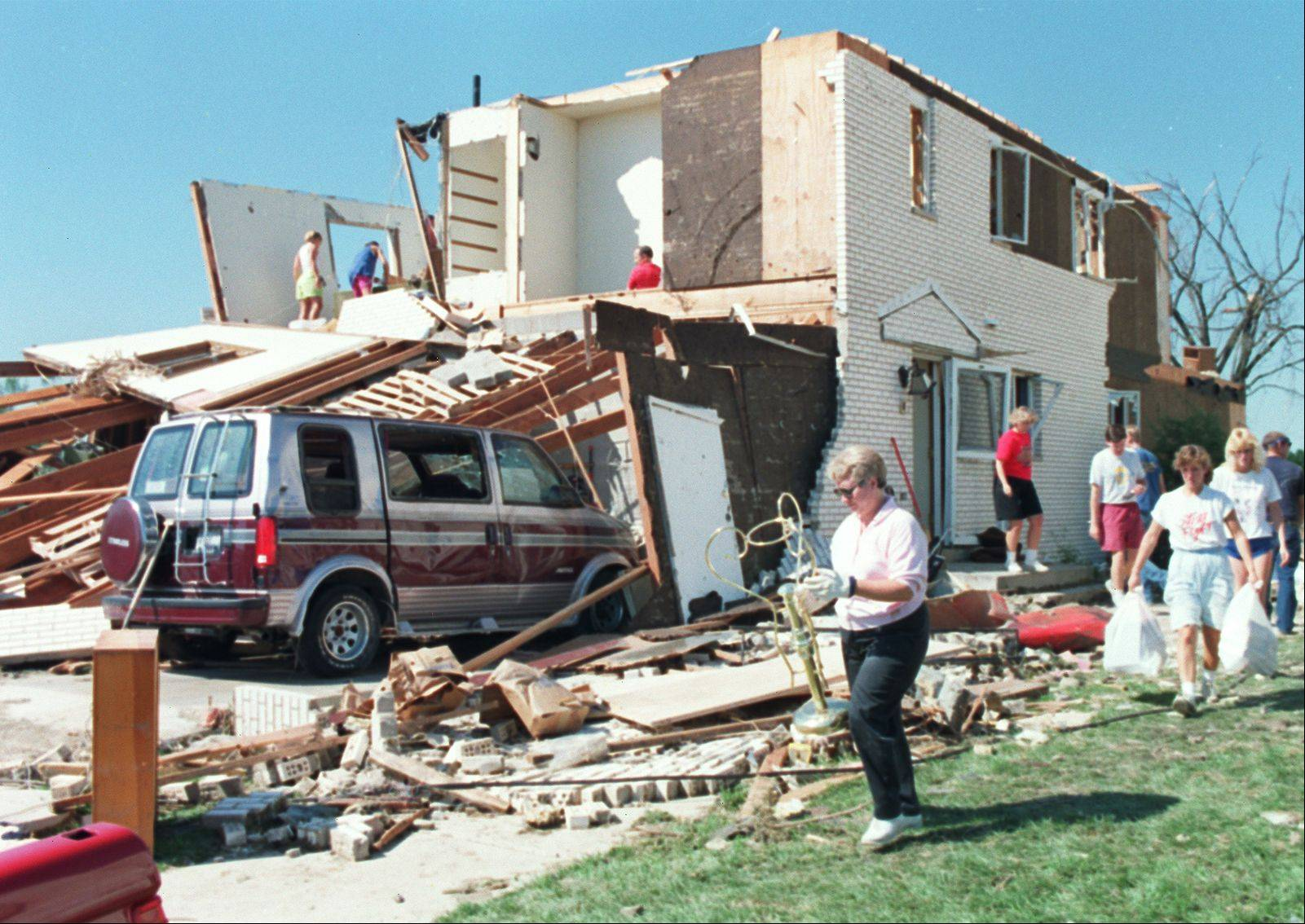 Plainfield residents look over their destroyed homes after the Aug. 28, 1990, tornado.