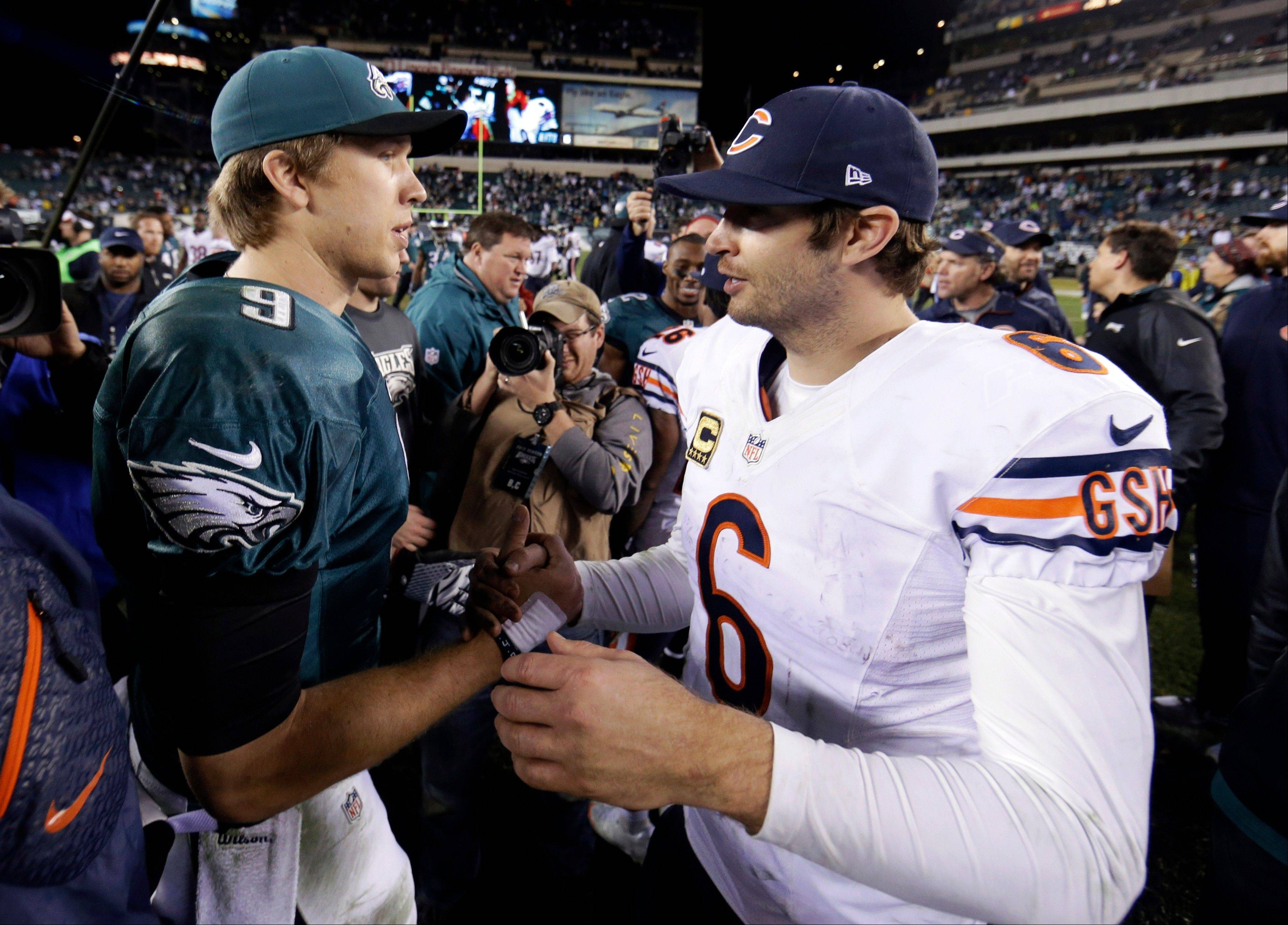 Bears quarterback Jay Cutler, right, meets with Philadelphia Eagles QB Nick Foles after Sunday's game.