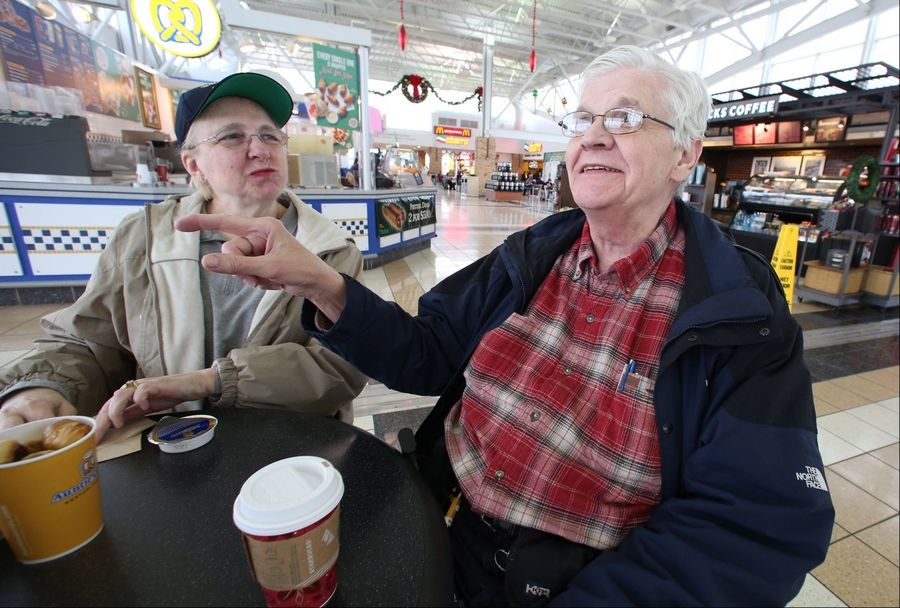 George LeClaire/gleclaire@dailyherald.comBob Szumski and his wife, Ursela, both of Madison, Wis., take a break at the Des Plaines Oasis. The couple say they regularly stop at the Oasis on trips to and from the East Coast.