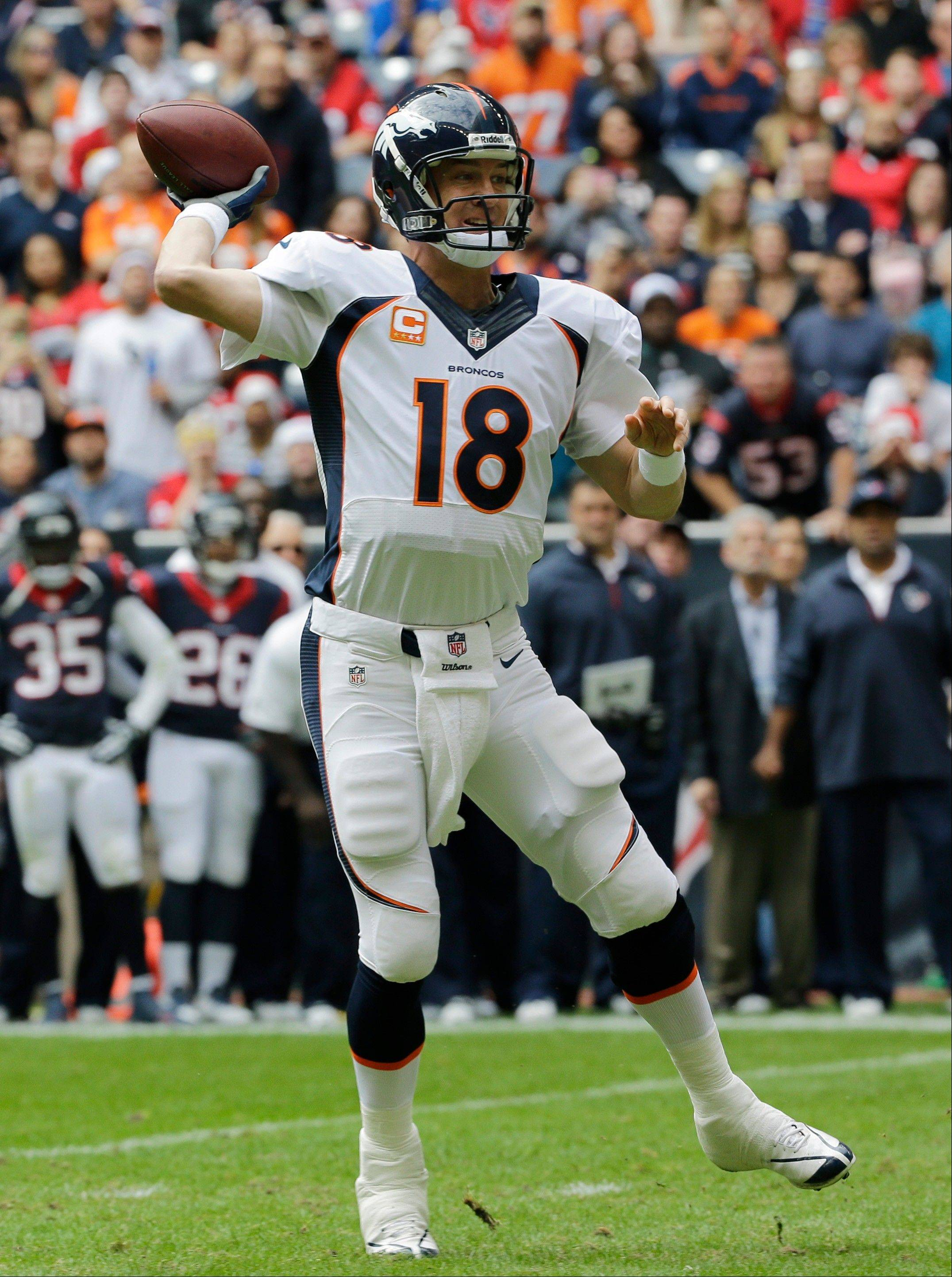 After breaking Tom Brady's single-season touchdown record of 50 on Sunday, Denver QB Peyton Manning is 266 yards from breaking Drew Brees' single-season mark for yards passing.