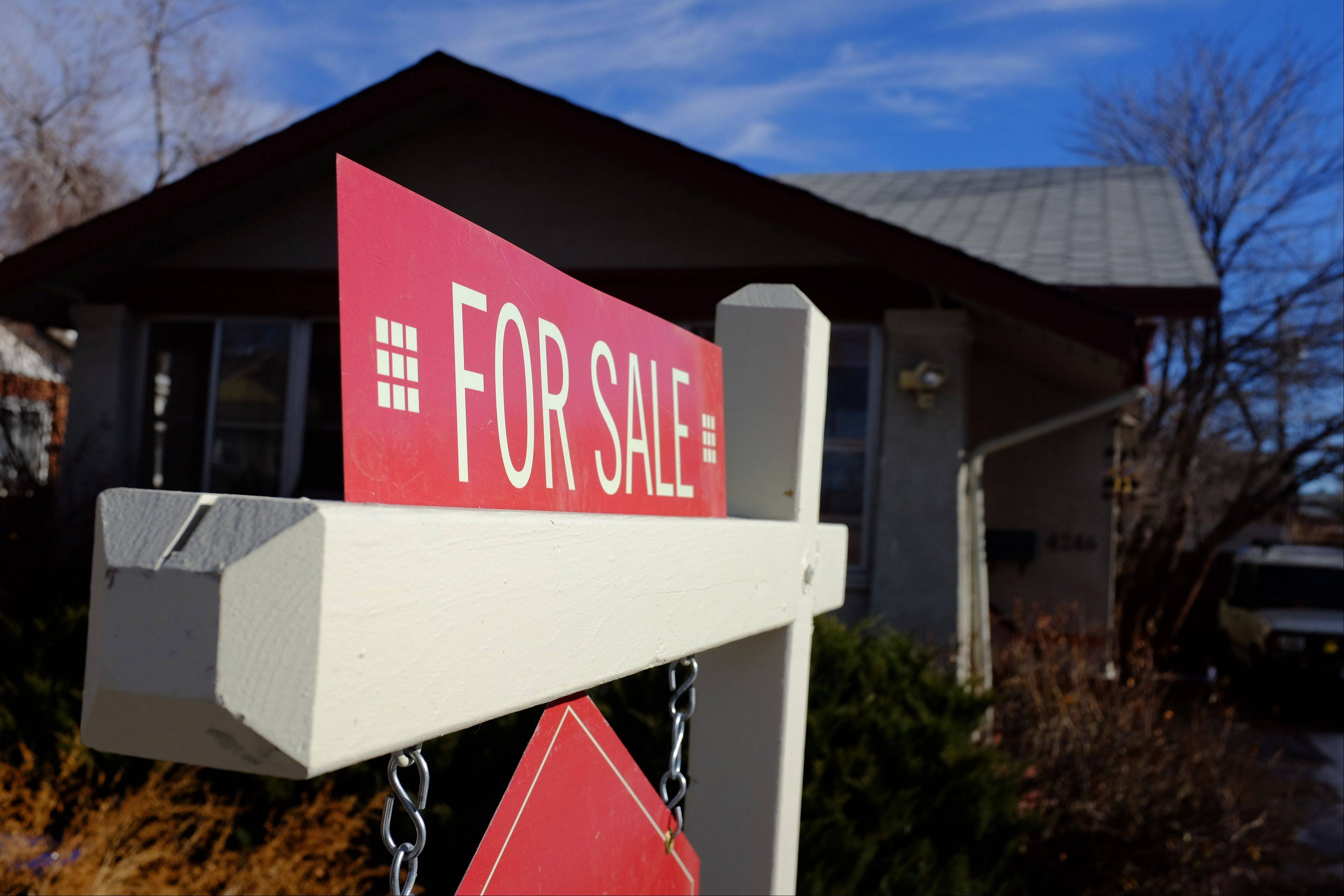 "A ""For Sale"" sign stands in the yard of a single family home in Denver, Colorado, U.S."