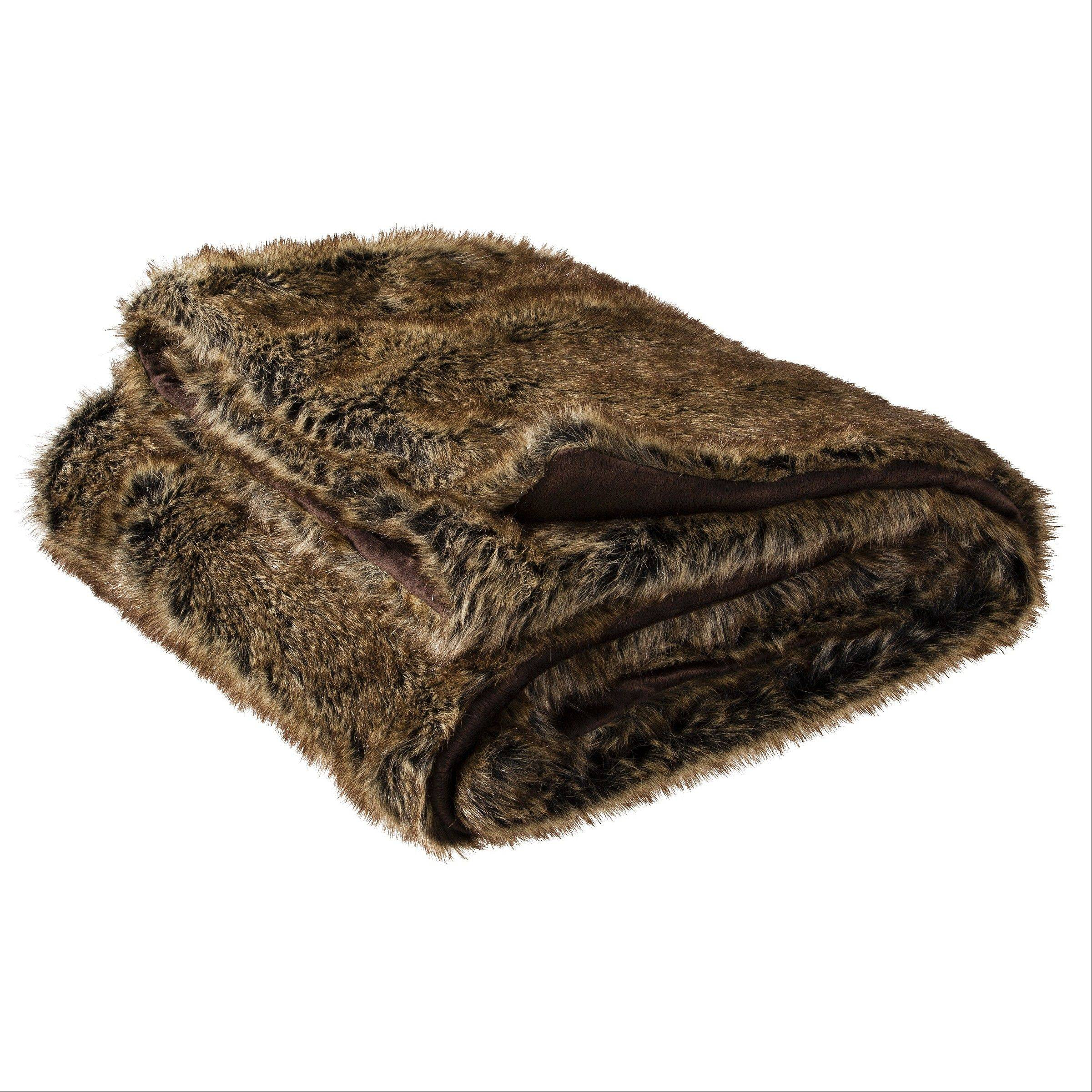 This image provided by Target shows the Threshold Faux Fur Throw in Brown. From faux fur coats to 'vegan leather' accents, faux fur gifts are trending, in 2013.