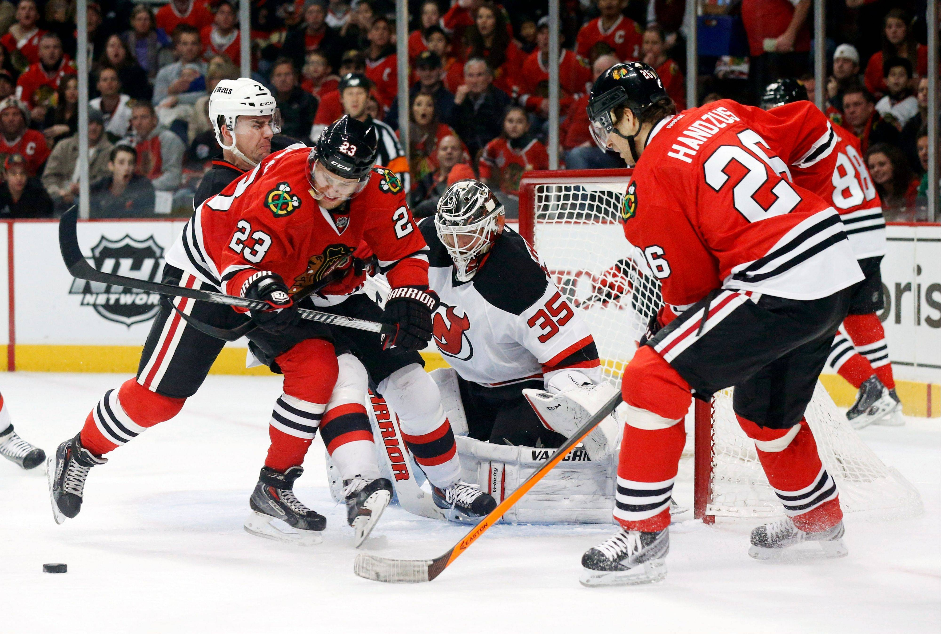 It's no surprise to the Blackhawks that Kris Versteeg, here trying to get a shot on Devils goalie Cory Schneider, has fit right in with the team a month after his return.