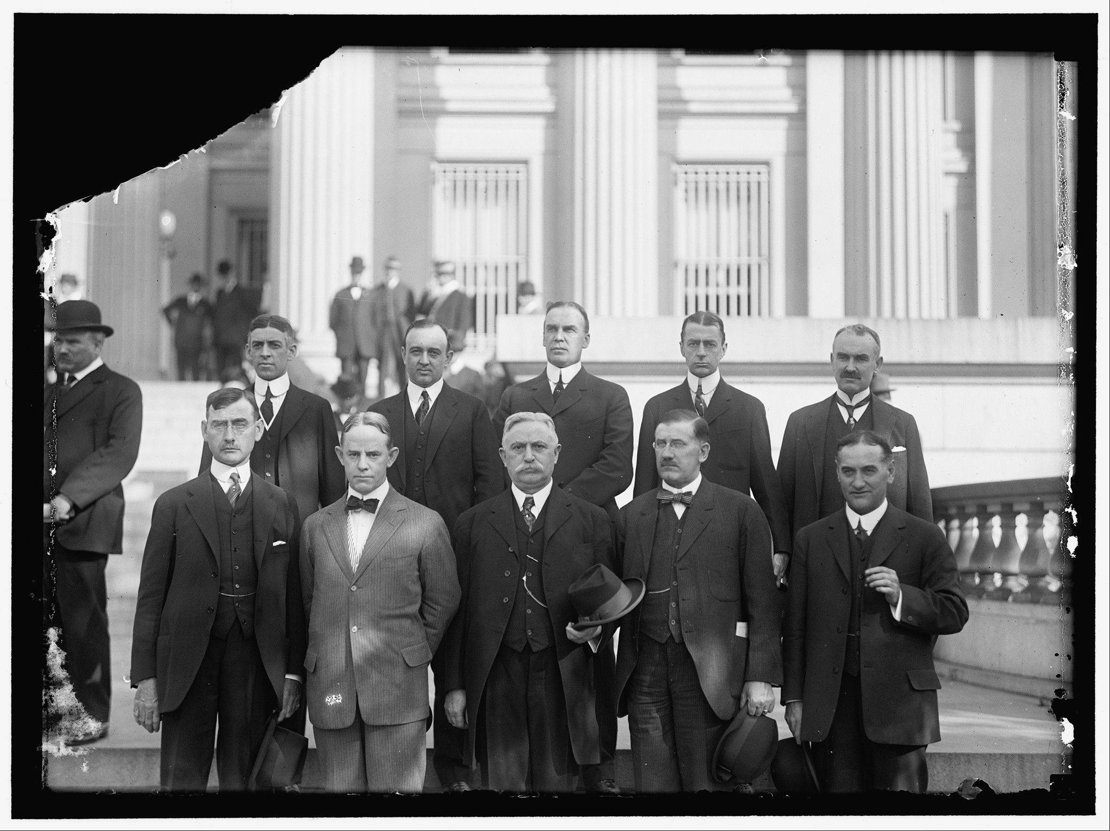 The original district governors of the Federal Reserve System are pictured here: Front row, from left, E. R. Francher, Cleveland, District 4; George J. Seay, Richmond, District. 5; Joseph A. McCord, Atlanta, District 6; Theodore Wold, Minneapolis, District 9; Charles M. Sawyer, Topeka, District 10. Back Row: Charles J. Rhoads, Philadelphia, District 3; Oscar Wells, Houston, District 11; Alfred L. Aiken, Boston, District 1; Benjamin Strong, New York, District 2; Archibald Kains, San Francisco, District 12.