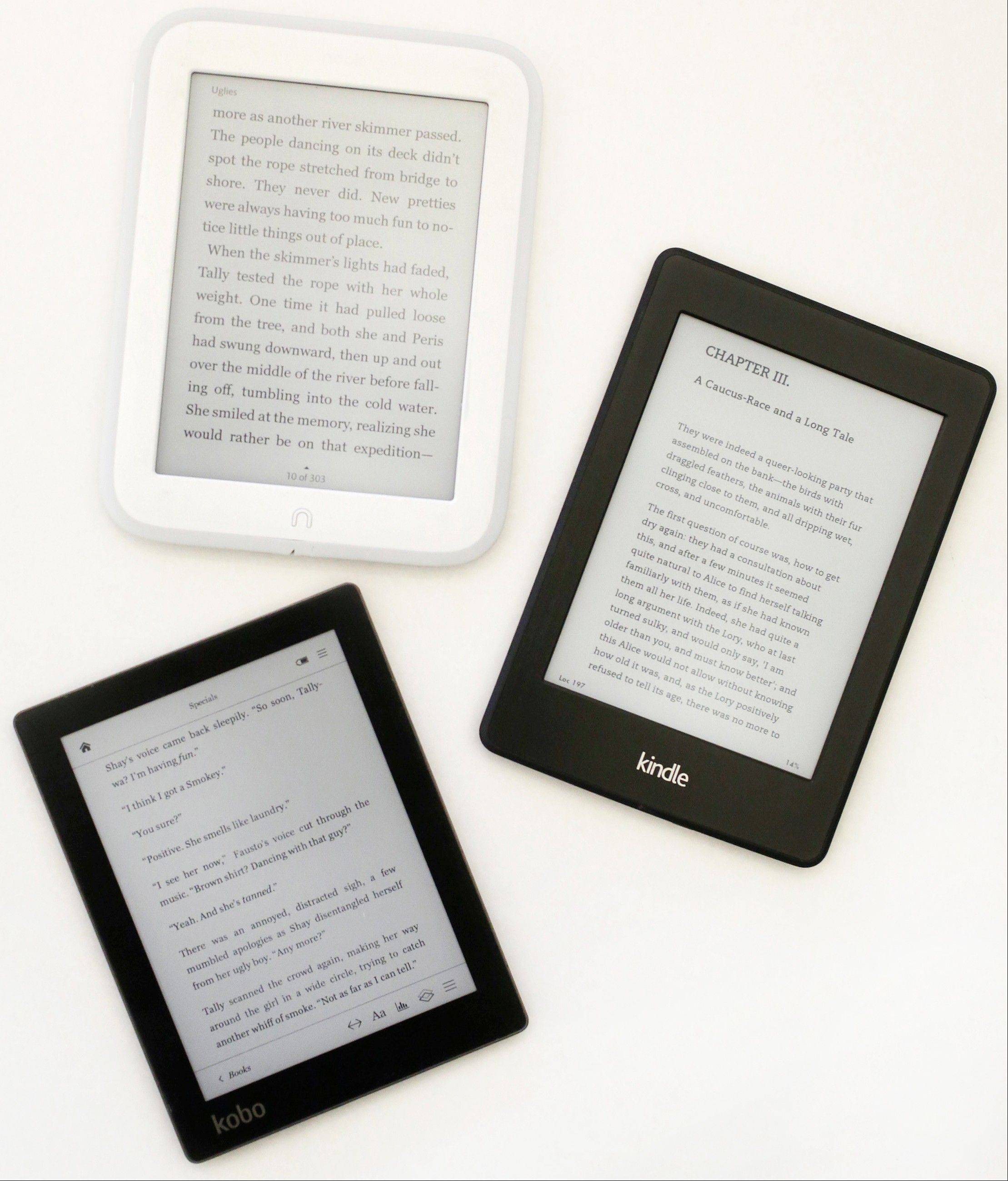 A Nook GlowLight, top, a Kindle Paperwhite, right, and a Kobo Aura. E-readers are cheaper than full-fledged tablets.