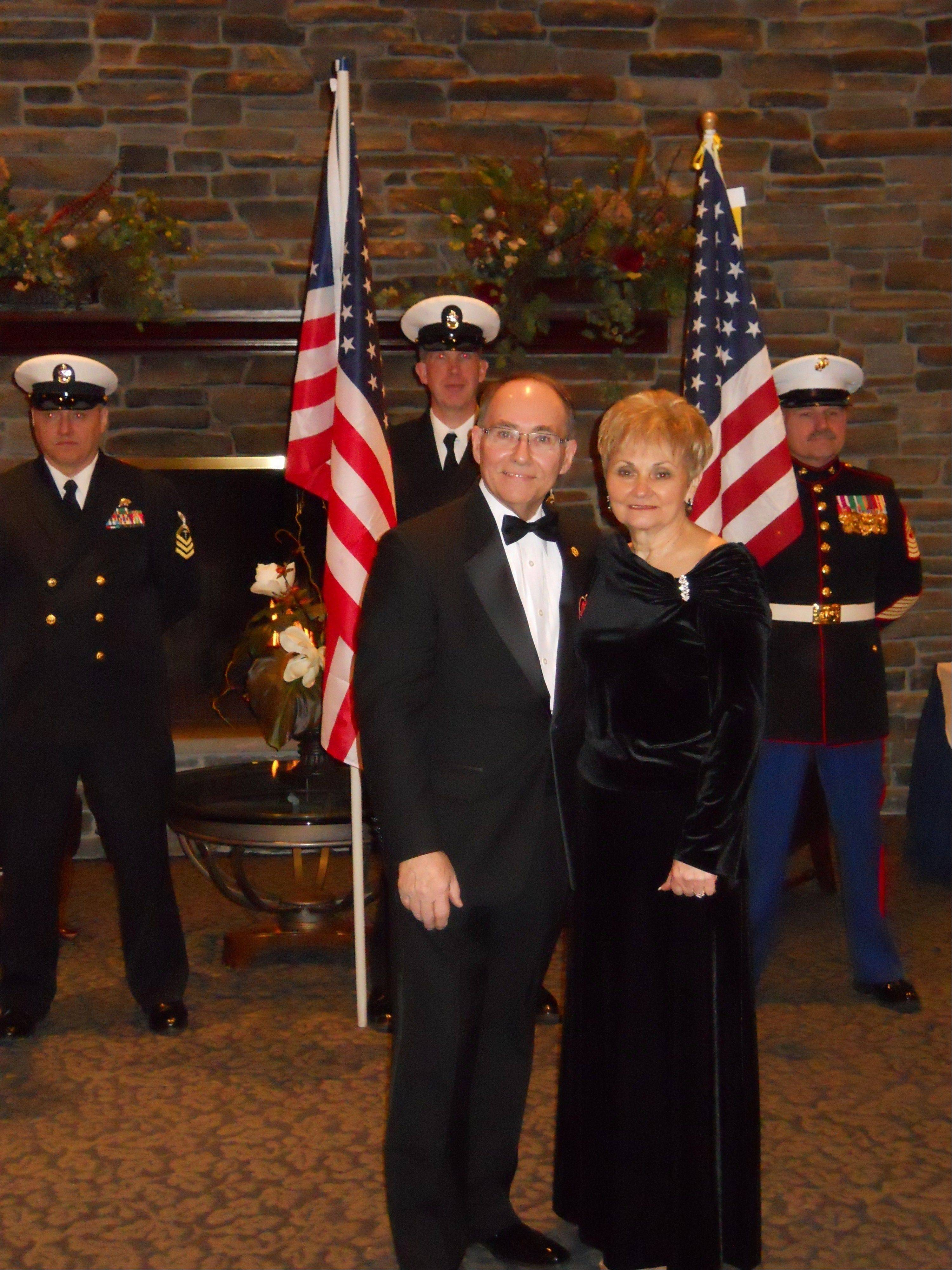 Roy and Georgette Frank greet guests as they arrive at the Hearts Of Valor Ball.