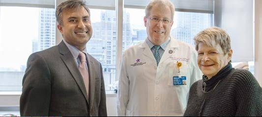 "Susan Fischer of Arlington Heights, right, talks with her doctors Dr. Ravi Kalhan, left, and Dr. Malcolm DeCamp, middle. ""Susan was the ideal candidate for lung volume reduction surgery,"" Kalhan says."