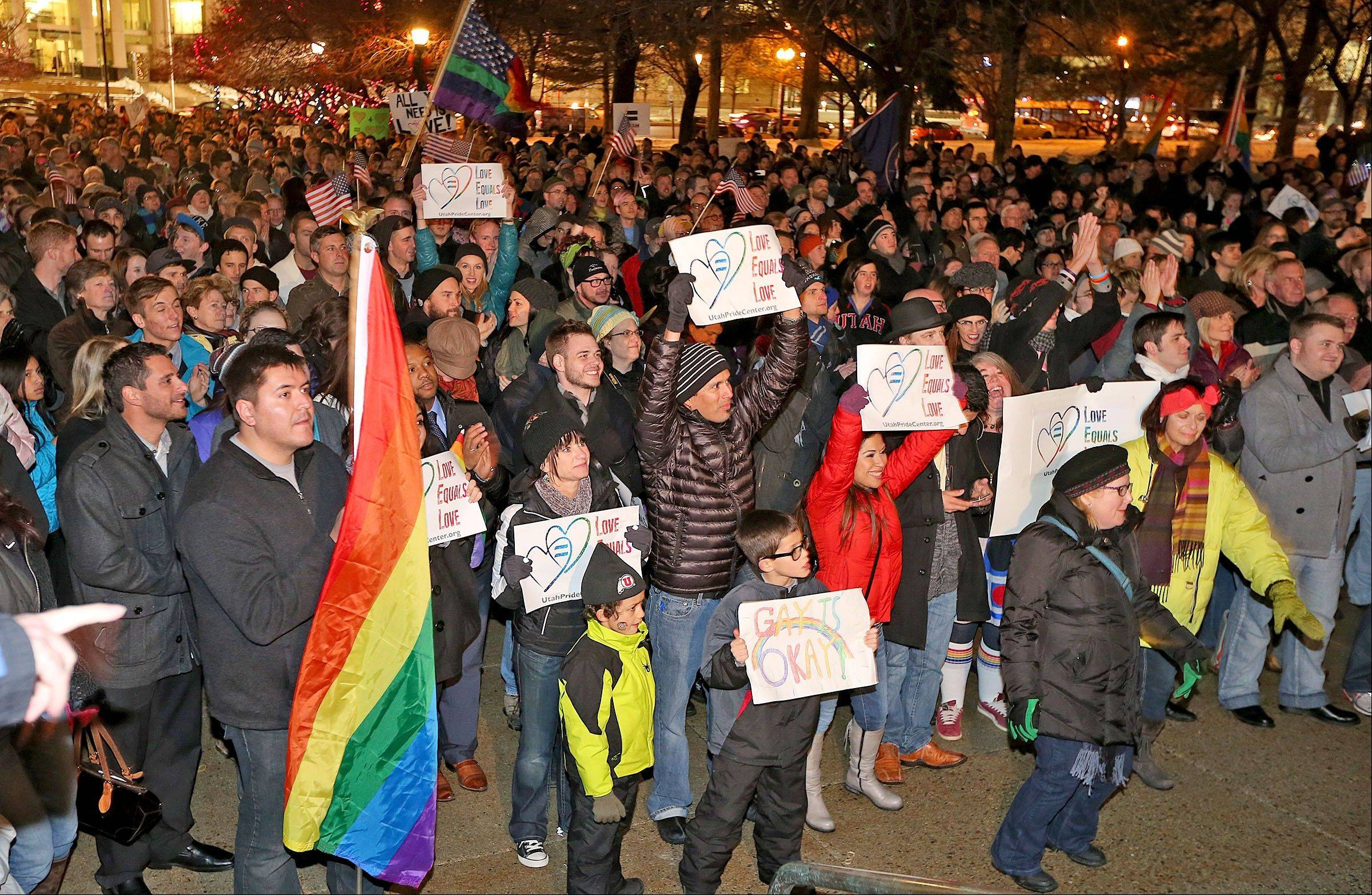 About 1,500 people gather Monday to celebrate marriage equality after a federal judge declined to stay his ruling that legalized same-sex marriage in Utah, at Washington Square just outside of the Salt Lake City and County Building.