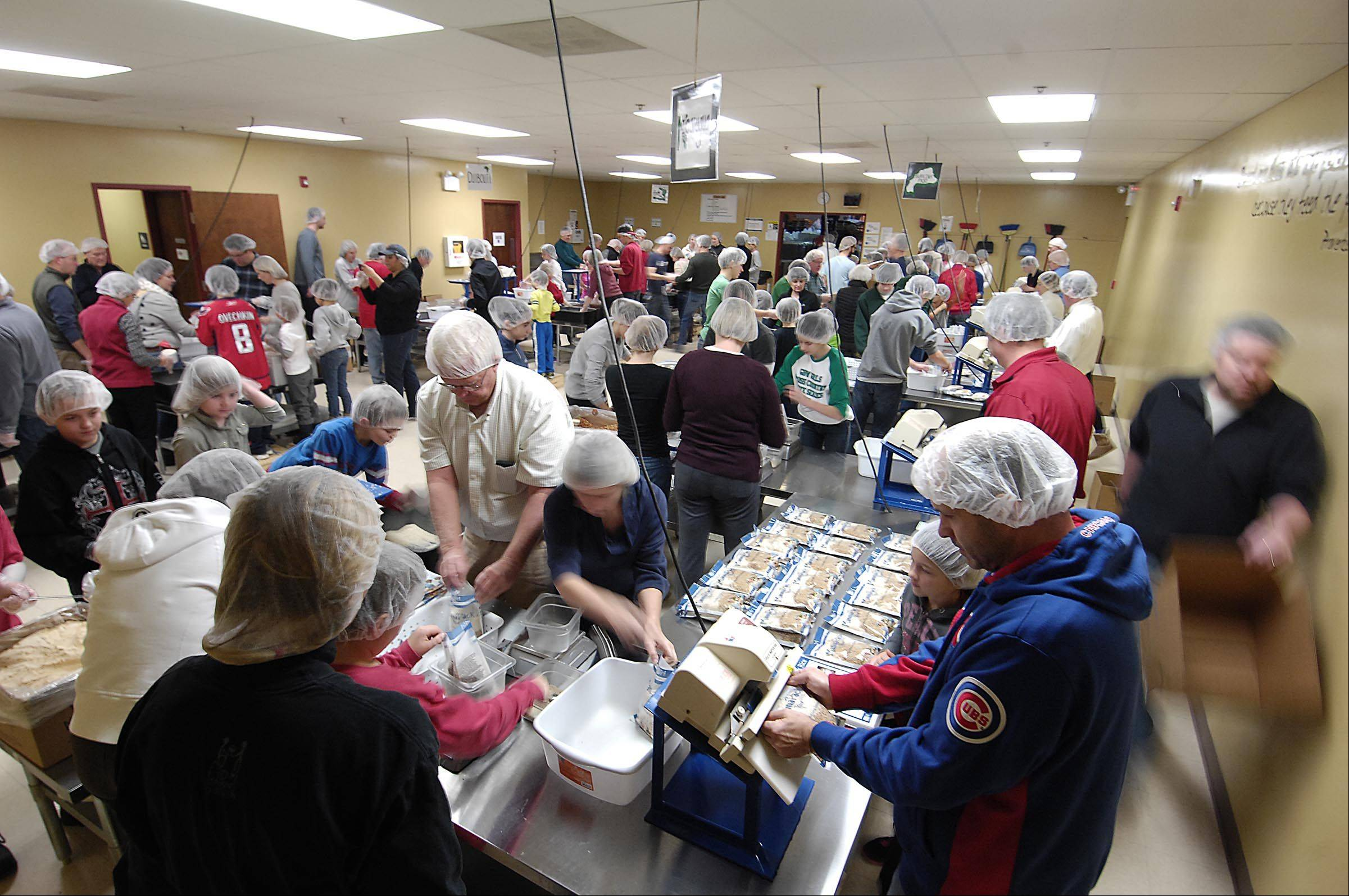 More than 100 people came to the Aurora facility Tuesday to pack specially engineered food packets.