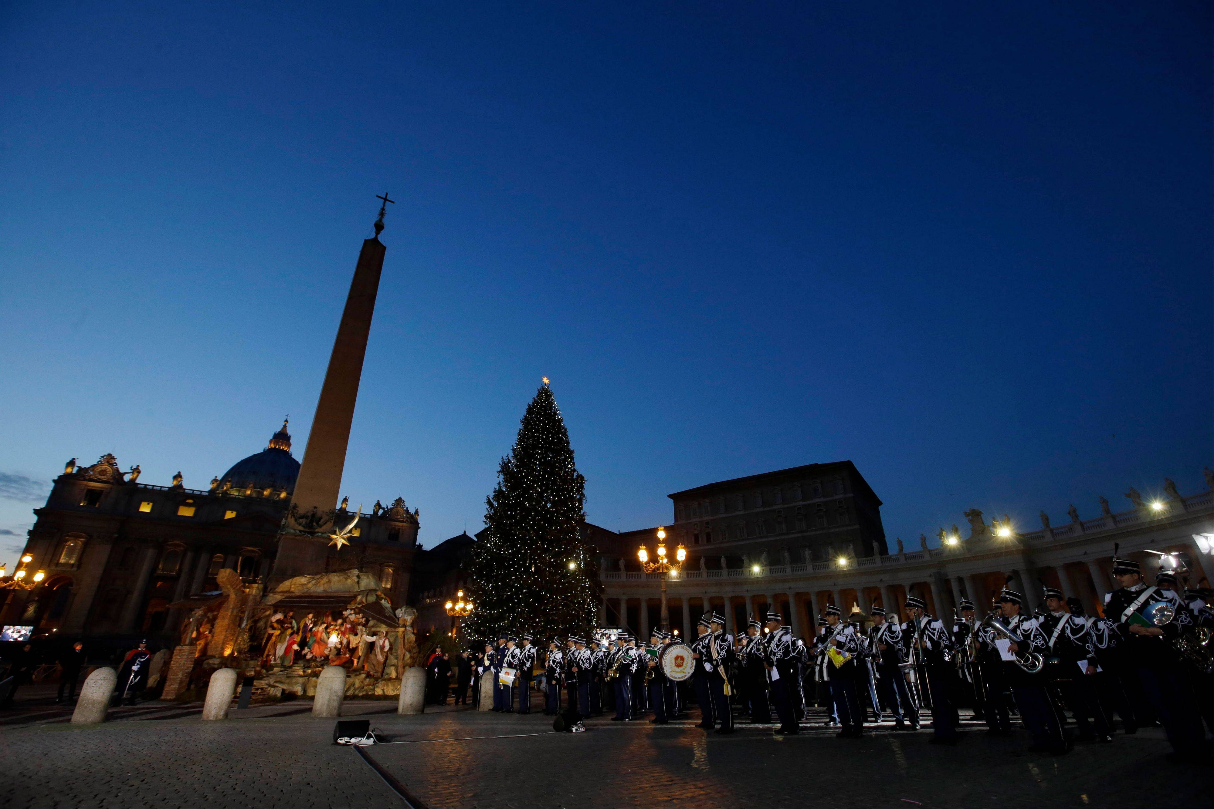The Vatican gendarmerie (police and security force) band plays as the nativity scene is unveiled in St. Peter's Square at the Vatican, Tuesday, Dec. 24, 2013.
