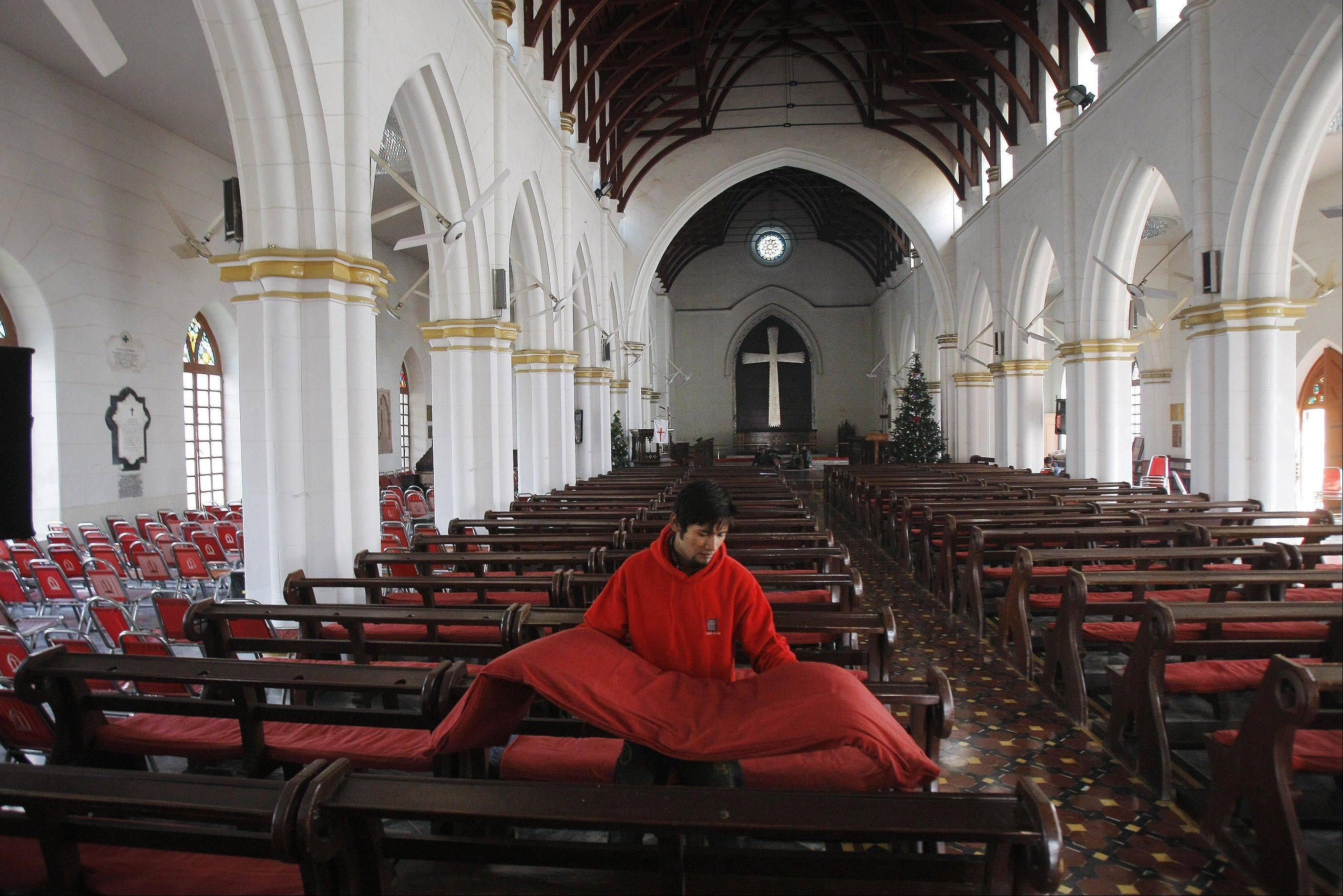 A Pakistani church employee prepares for Christmas mass in Peshawar, Pakistan, Tuesday, Dec. 24, 2013. Christians are a minority in Pakistan, they constitute about 1.6% of the Pakistan�s population.