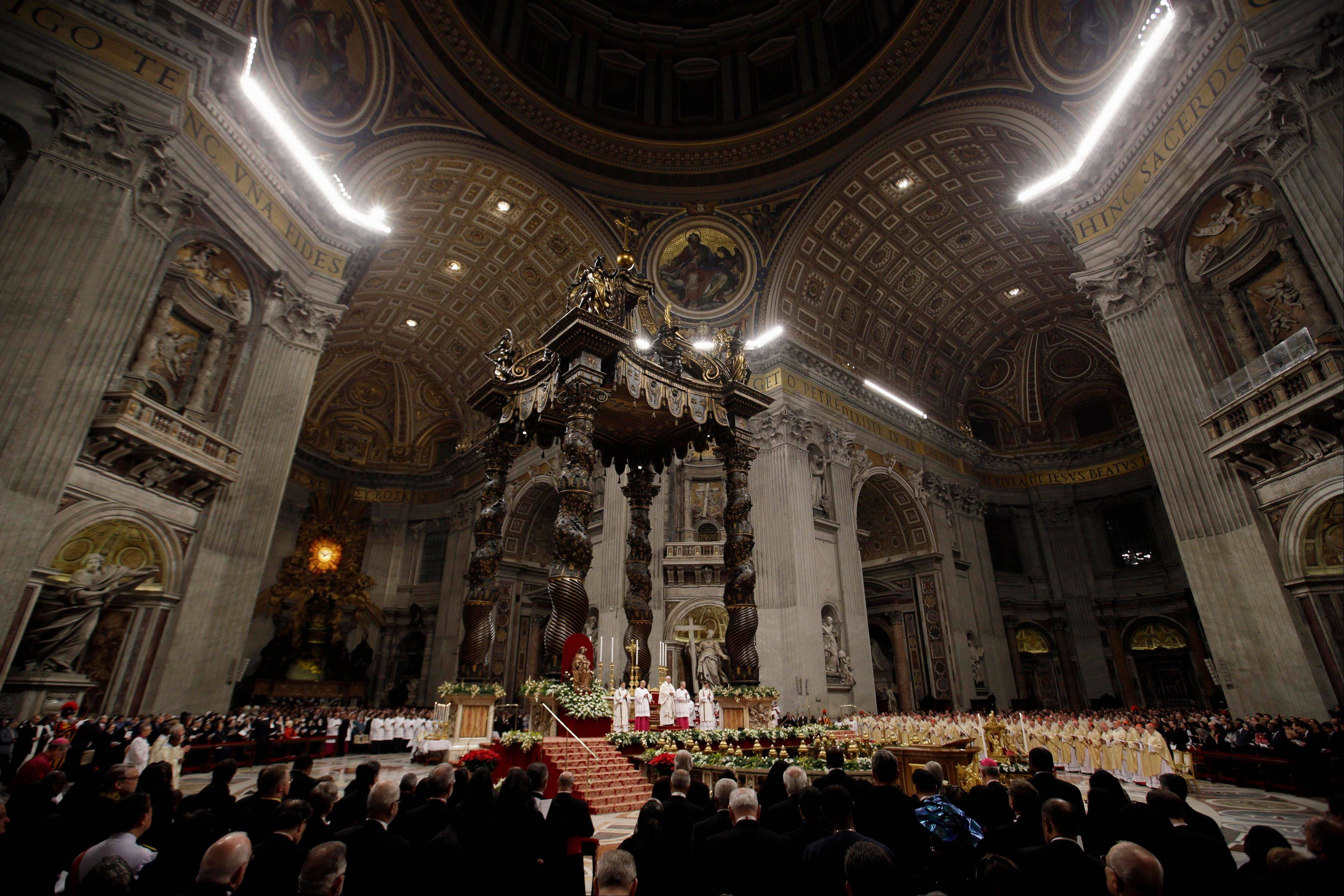 Pope Francis celebrates the Christmas Eve Mass in St. Peter's Basilica at the Vatican, Tuesday, Dec. 24, 2013. Pope Francis has begun celebrating his first Christmas Eve Mass as pontiff by placing a baby Jesus statue in a replica of a manger in St. Peter's Basilica.