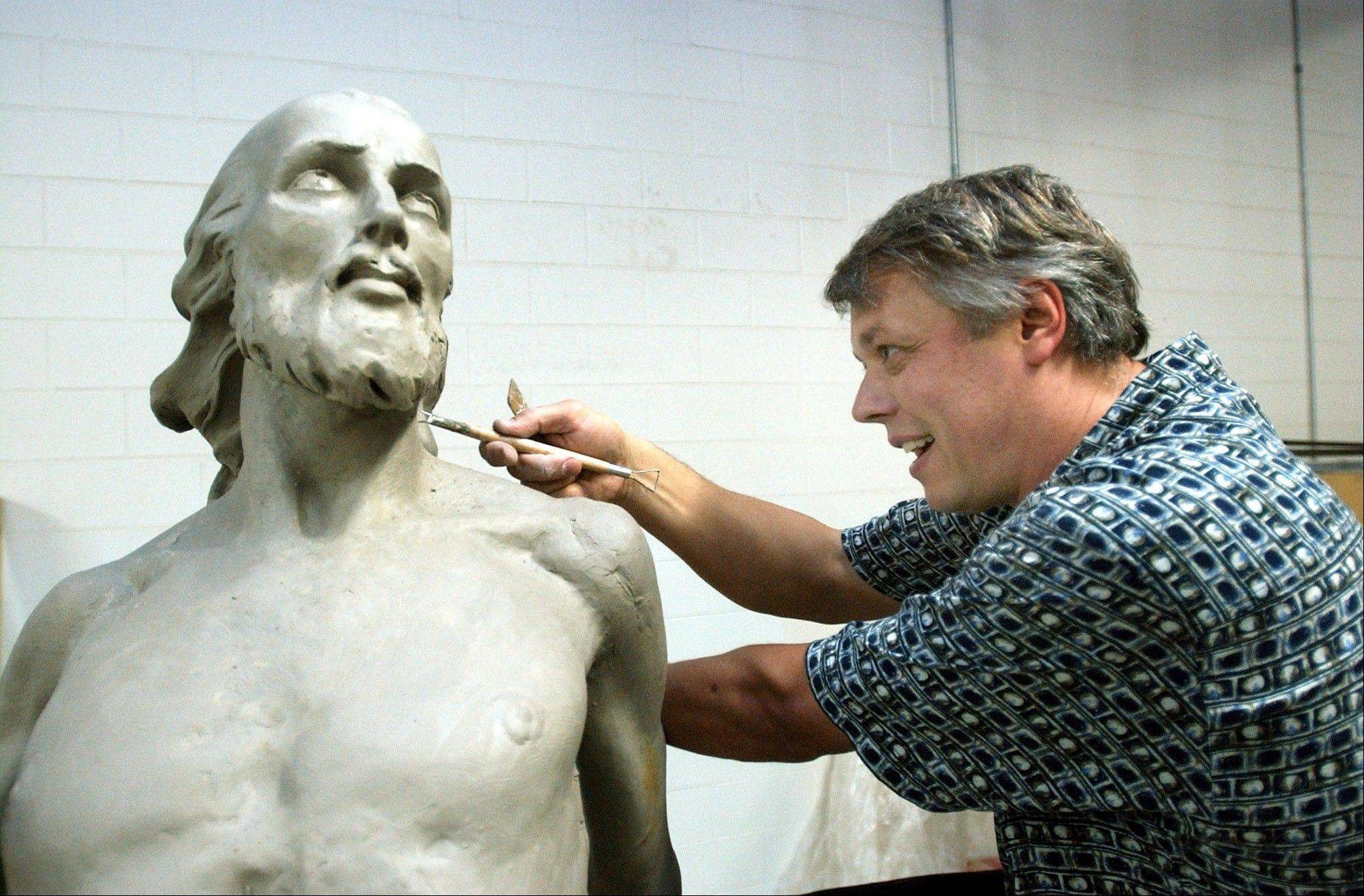 "Sergei Mitrofanov of Livonia, Mich., works on a clay sculpture titled ""Resurrection of Jesus Christ"" in his studio in Waterford Township, Mich., for the St. Bonaventure Monastery in Detroit. ""People in every culture portray Jesus looking like people they knew, î says Doug Jacobsen, a professor of church history and theology at Messiah College. ""They depict him as one of their own."""