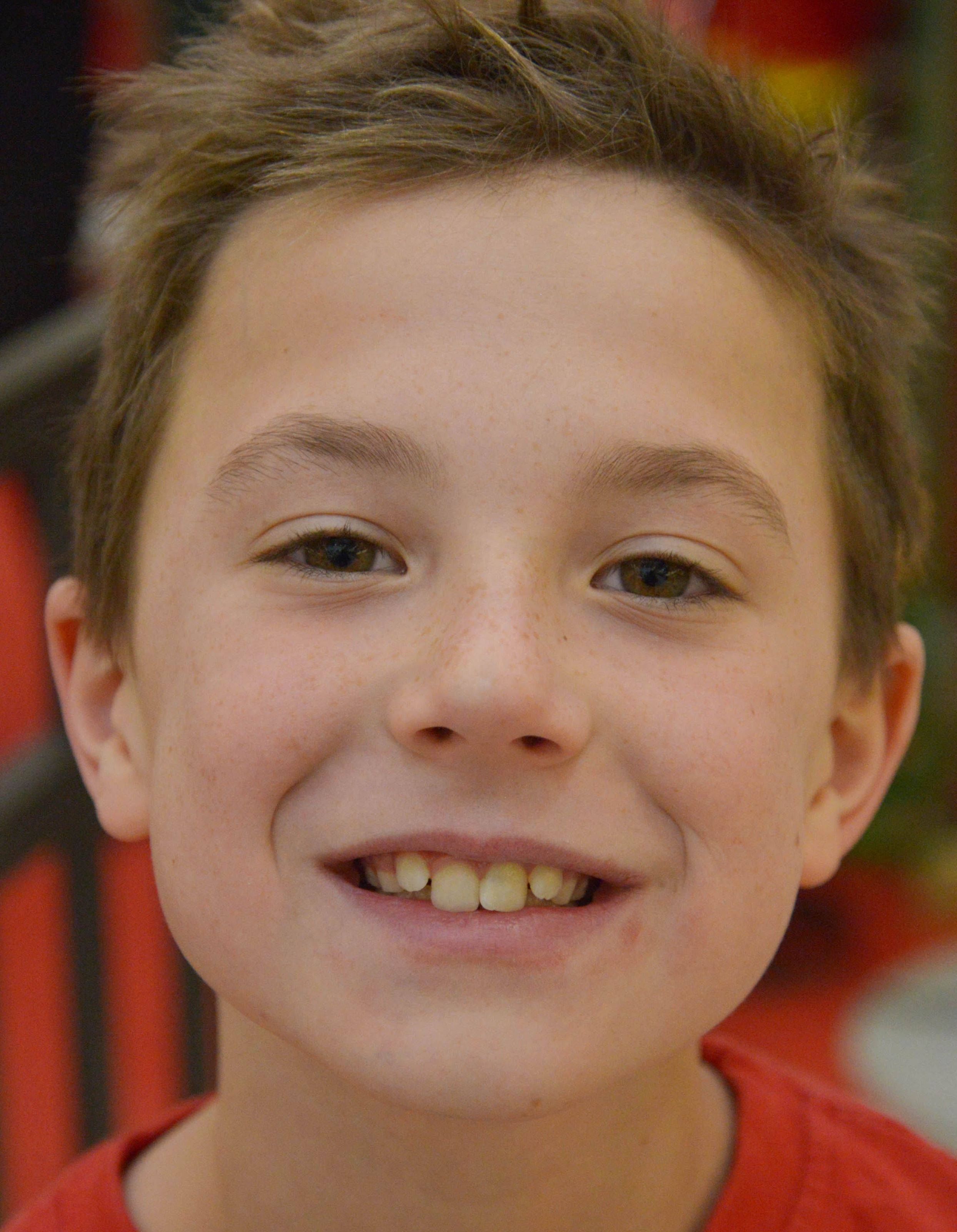 Logan Brown, 8, of Glen Ellyn, wants basketball shoes.