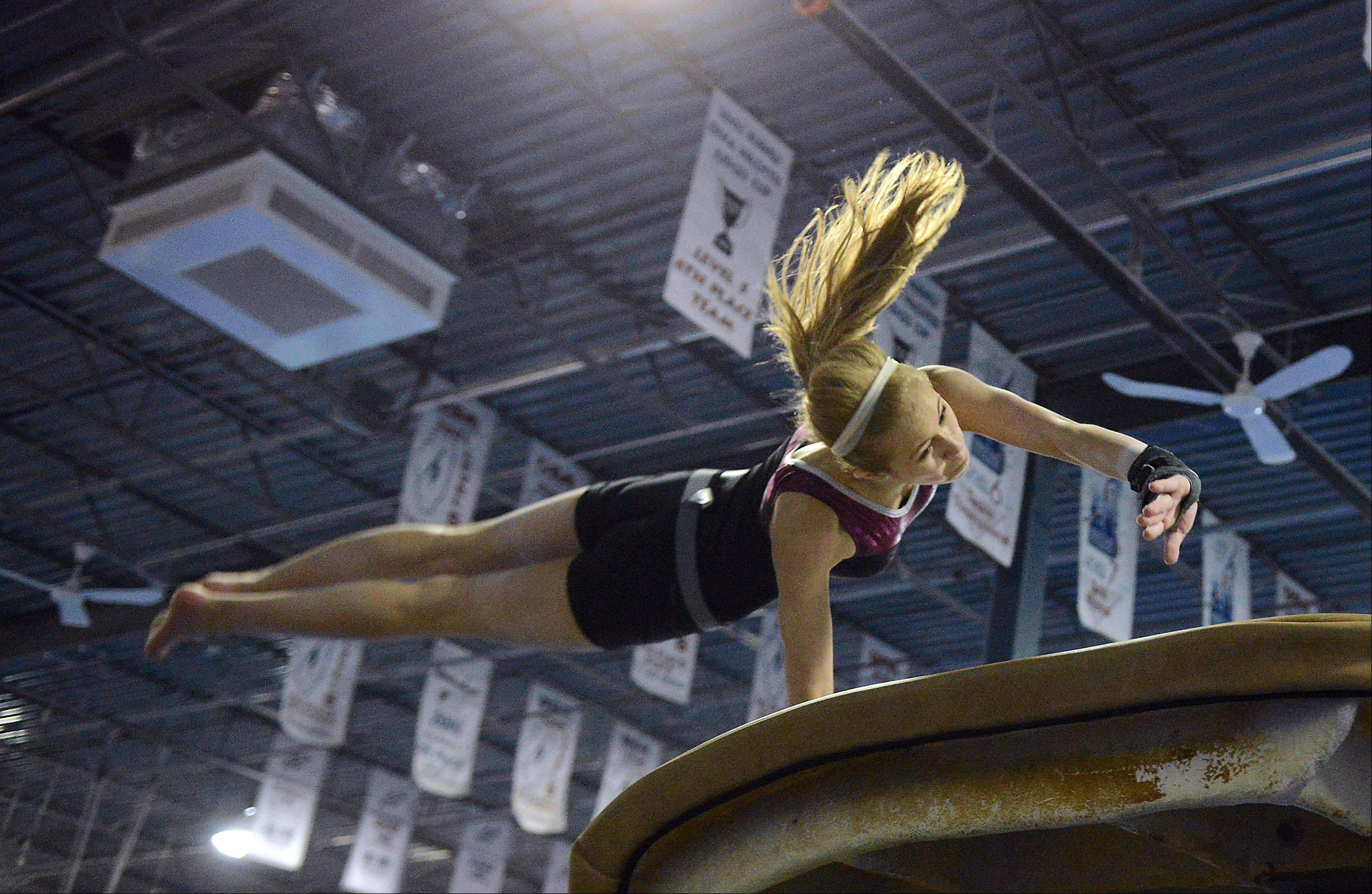 Ashley McKee of the U-46 co-op gymnastics team works on the vault during practice in Hanover Park Monday.