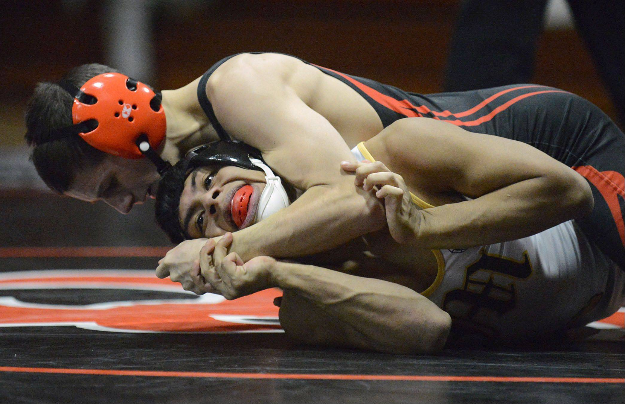 St. Charles East's Anthony Rubino takes the win in the 113-pound match against Metea Valley's Axl Ariza on Thursday.