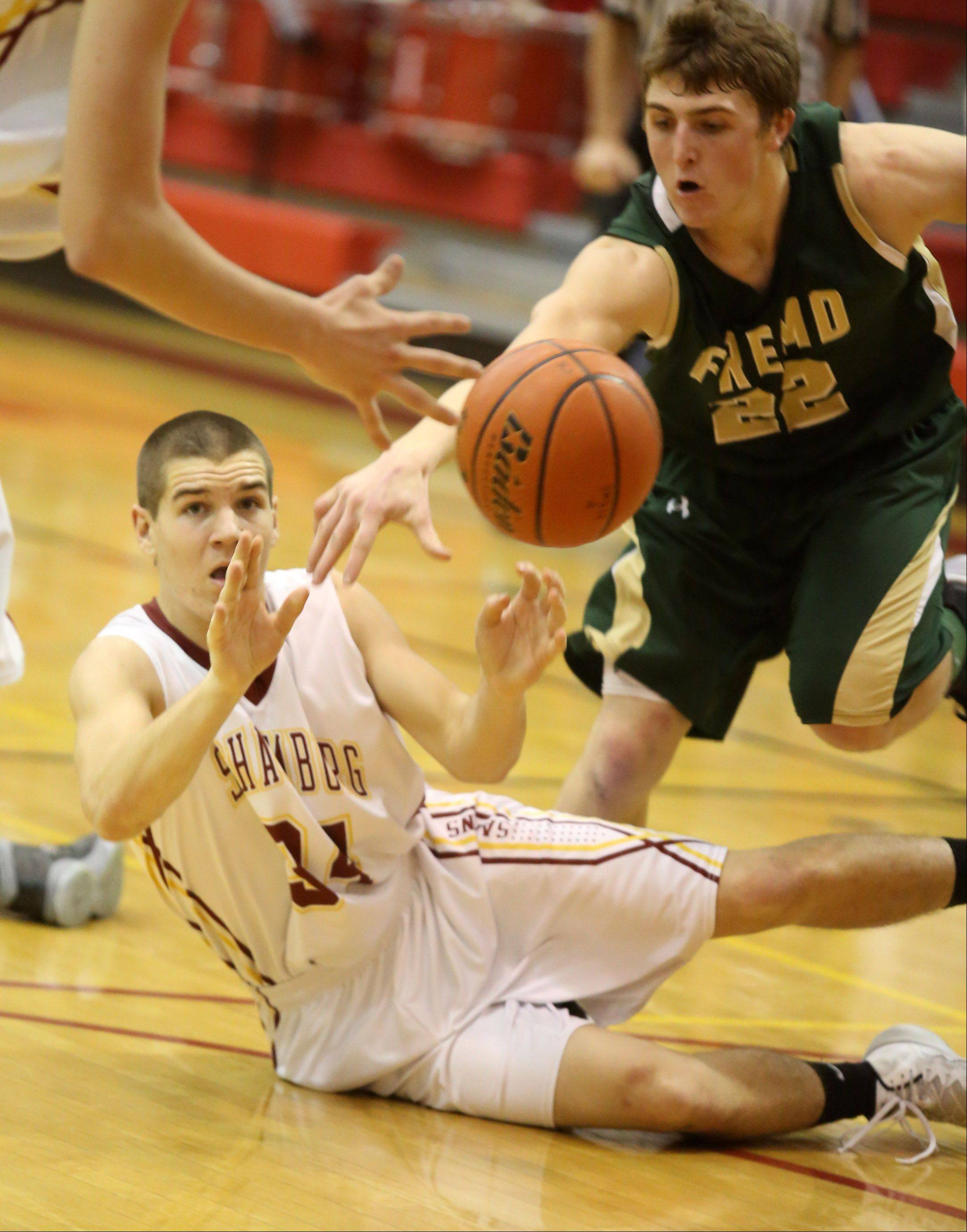 Schaumburg's Christopher Mullaney passes from the floor as Fremd's Garrett Groot pressures on Friday in Schaumburg.